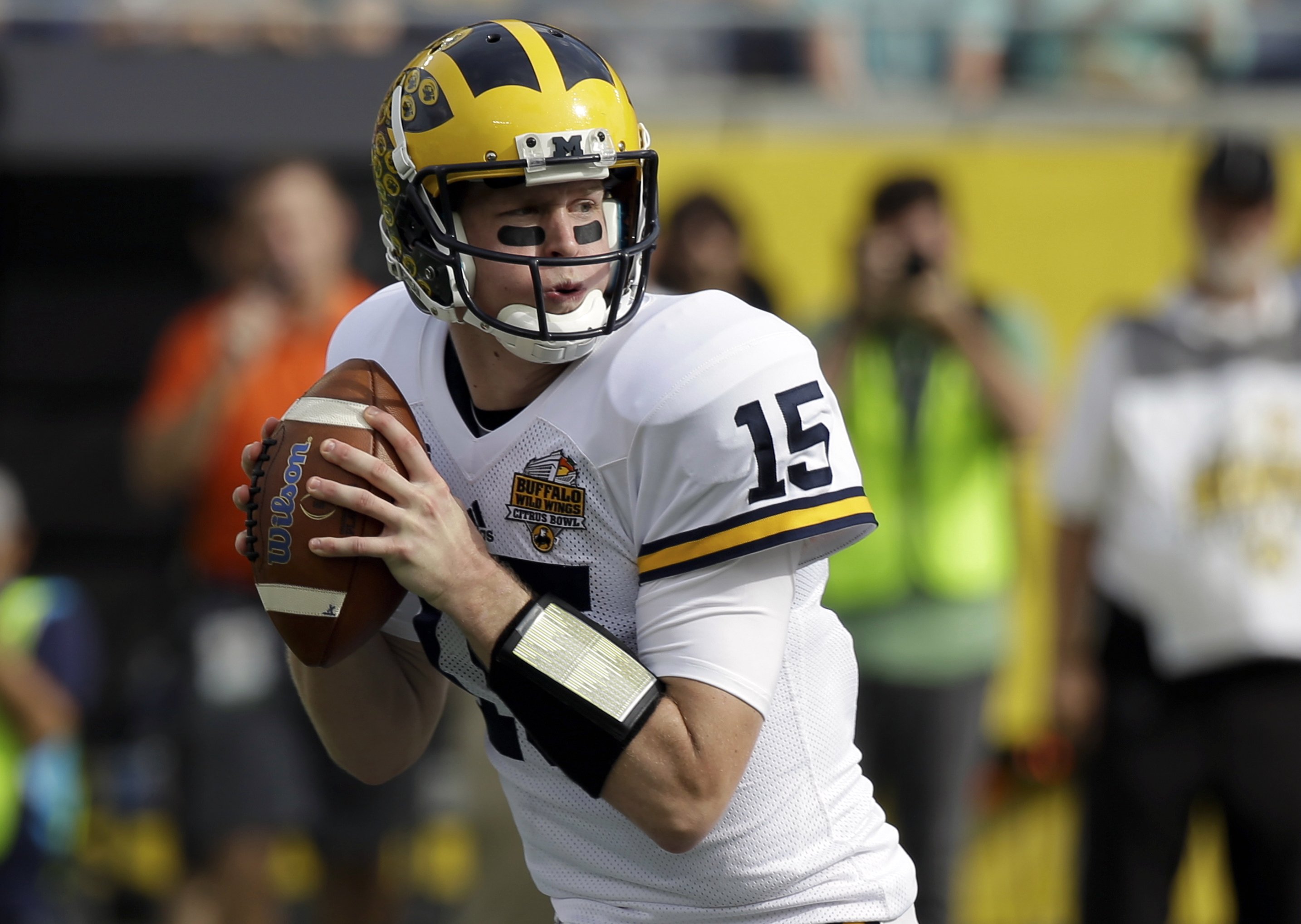 FILE - In this Jan. 1, 2016, file photo, Michigan quarterback Jake Rudock looks for a receiver during the first half of the Citrus Bowl NCAA college football game against Florida in Orlando, Fla. The former Michigan quarterback seems to have landed in a g