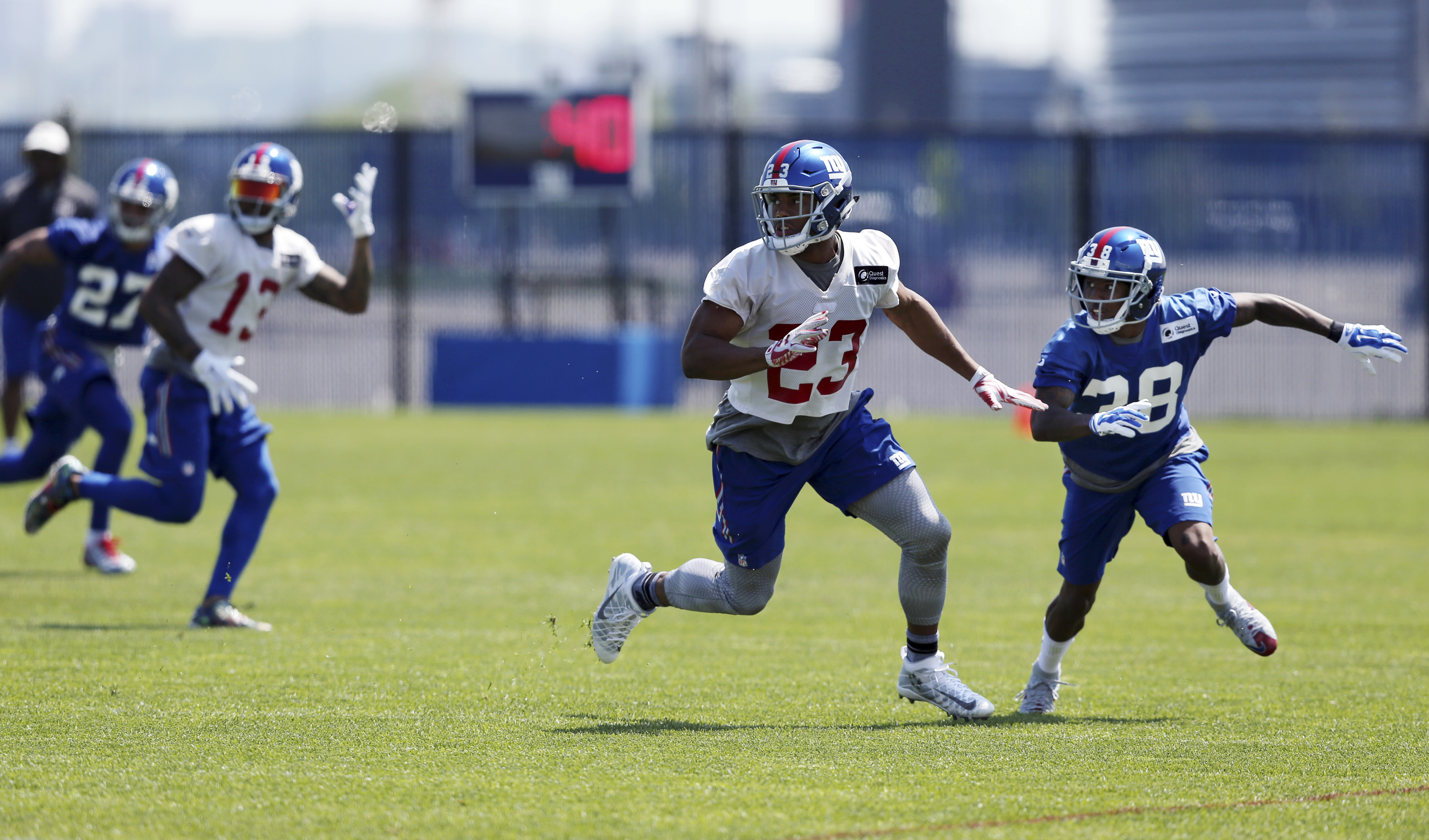 New York Giants running back Rashad Jennings (23) and corner back Donte Deayon (38) run together during football practice Monday, May 23, 2016 in East Rutherford, N.J. (AP Photo/Mel Evans)