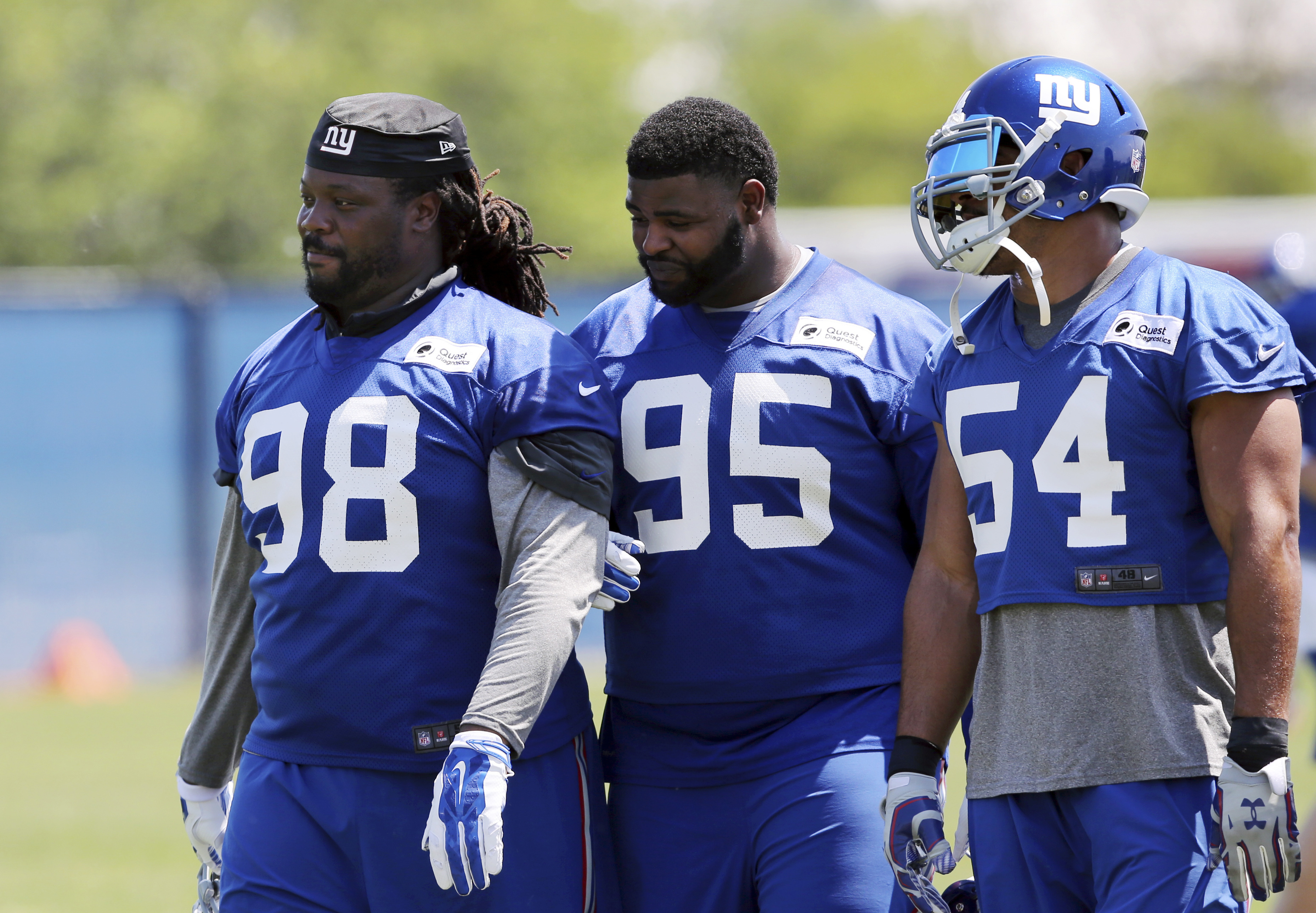 New York Giants defensive tackles Damon Harrison (98) and Johnathan Hankins (95) walk on the field with defensive end Olivier Vernon (54) during NFL football practice Monday, May 23, 2016 in East Rutherford, N.J. (AP Photo/Mel Evans)