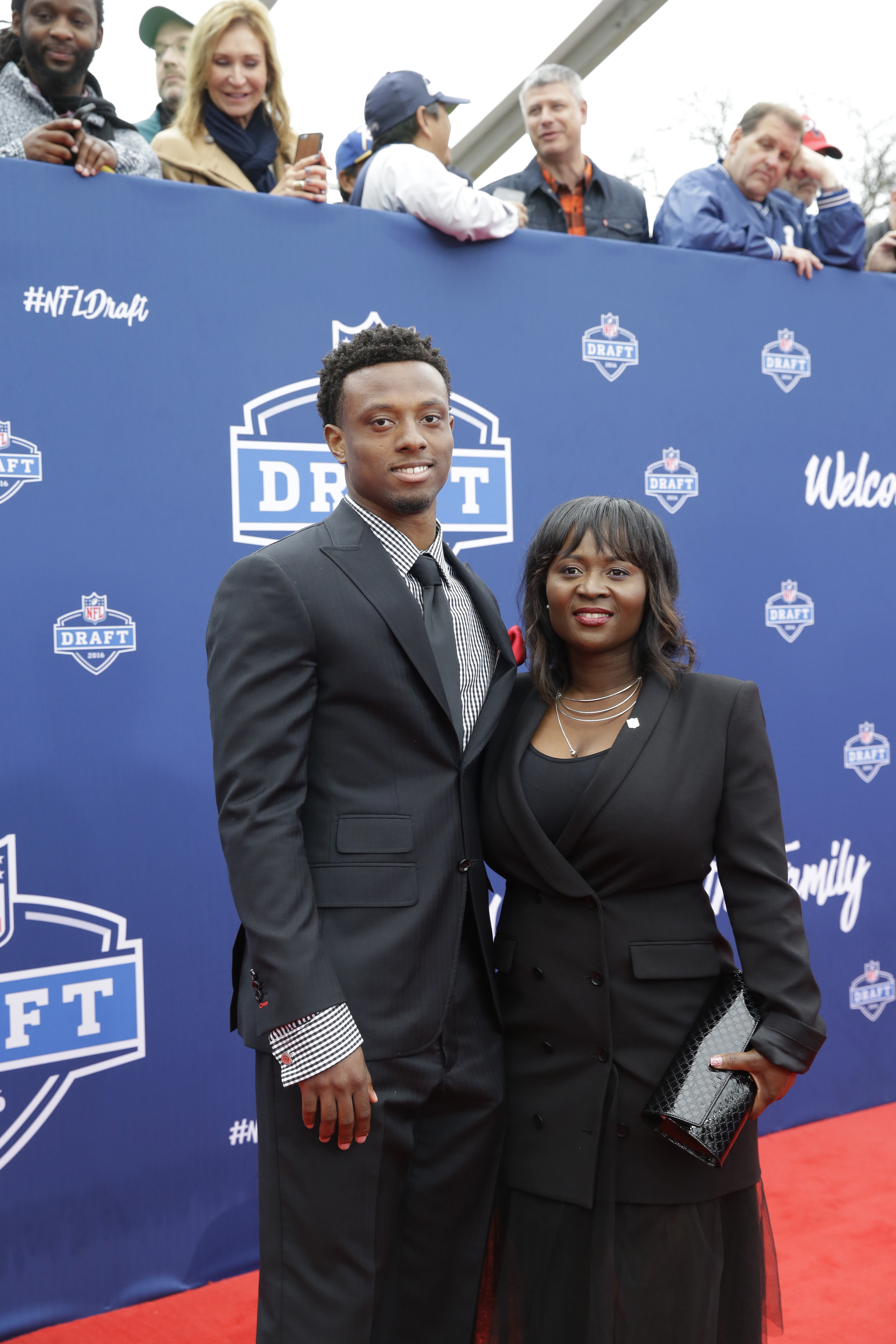 Ohio States Eli Apple, left, poses for photos upon arriving for the first round of the 2016 NFL football draft at the Auditorium Theater of Roosevelt University, Thursday, April 28, 2016, in Chicago. (AP Photo/Nam Y. Huh)