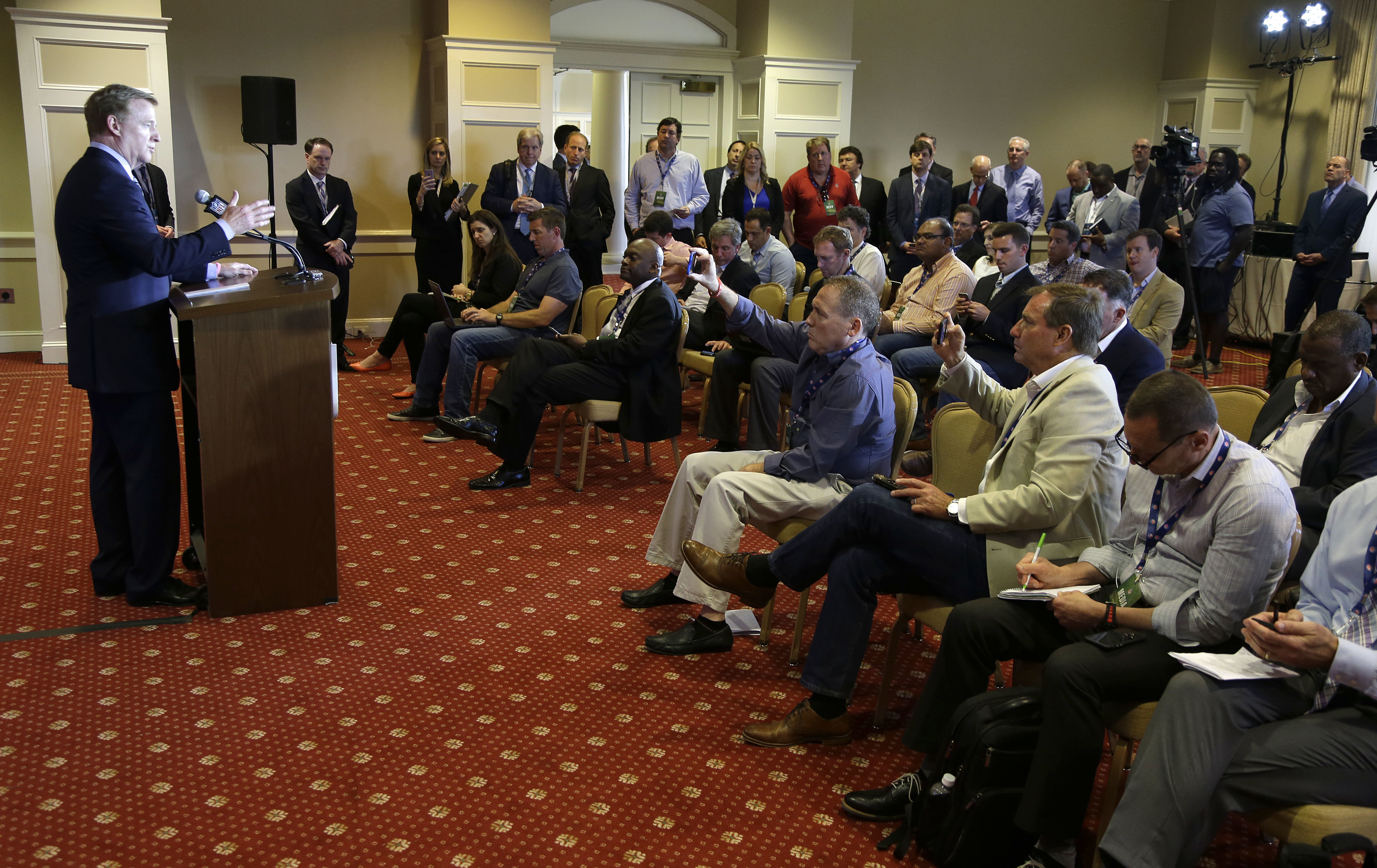 NFL commissioner Roger Goodell answers reporter's questions following a vote that awarded the Super Bowl to Atlanta (2019), Miami (2020) and Los Angeles (2021) at the NFL owner's meeting in Charlotte N.C., Tuesday, May 24, 2016. (AP Photo/Bob Leverone)