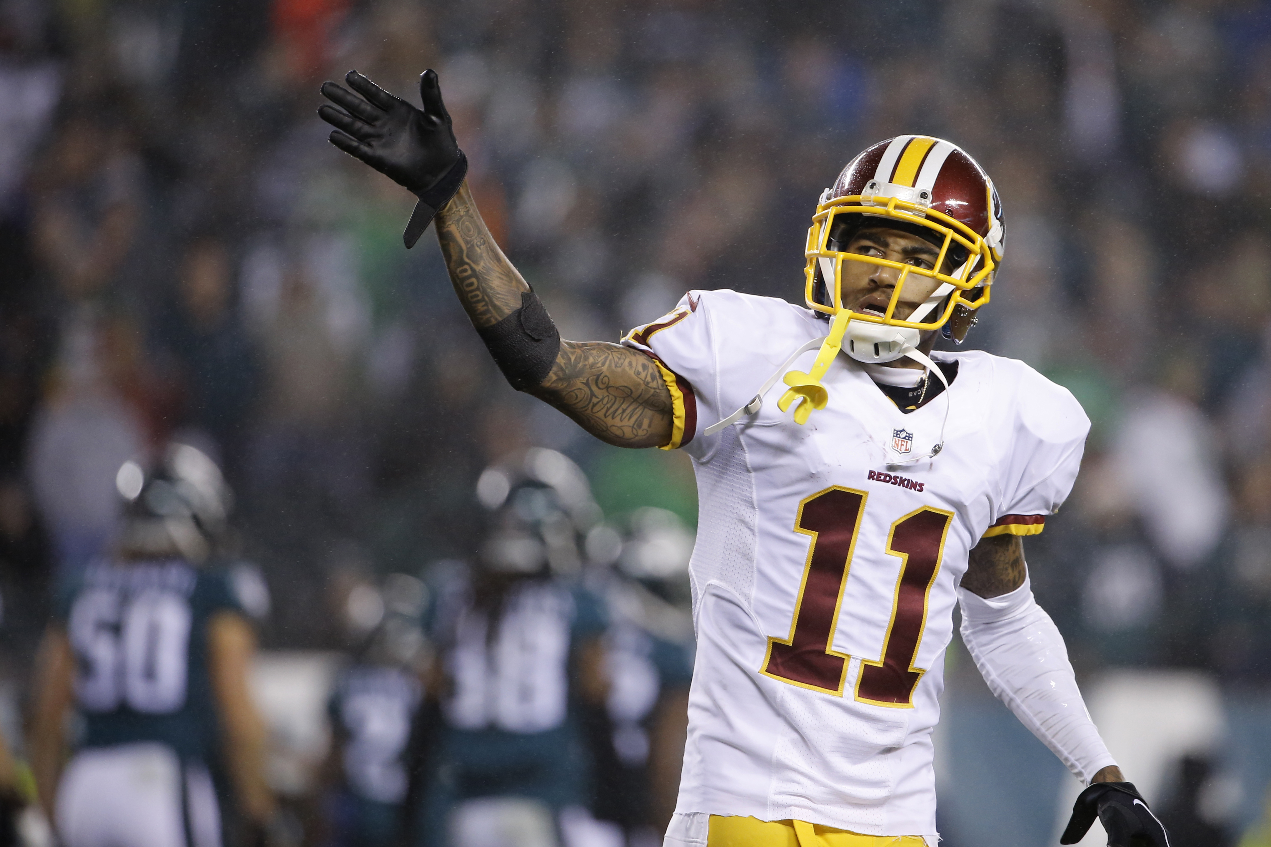Washington Redskins' DeSean Jackson reacts after a two-point conversion by Jamison Crowder in the second half of an NFL football game against the Philadelphia Eagles, Saturday, Dec. 26, 2015, in Philadelphia.  (AP Photo/Matt Rourke)