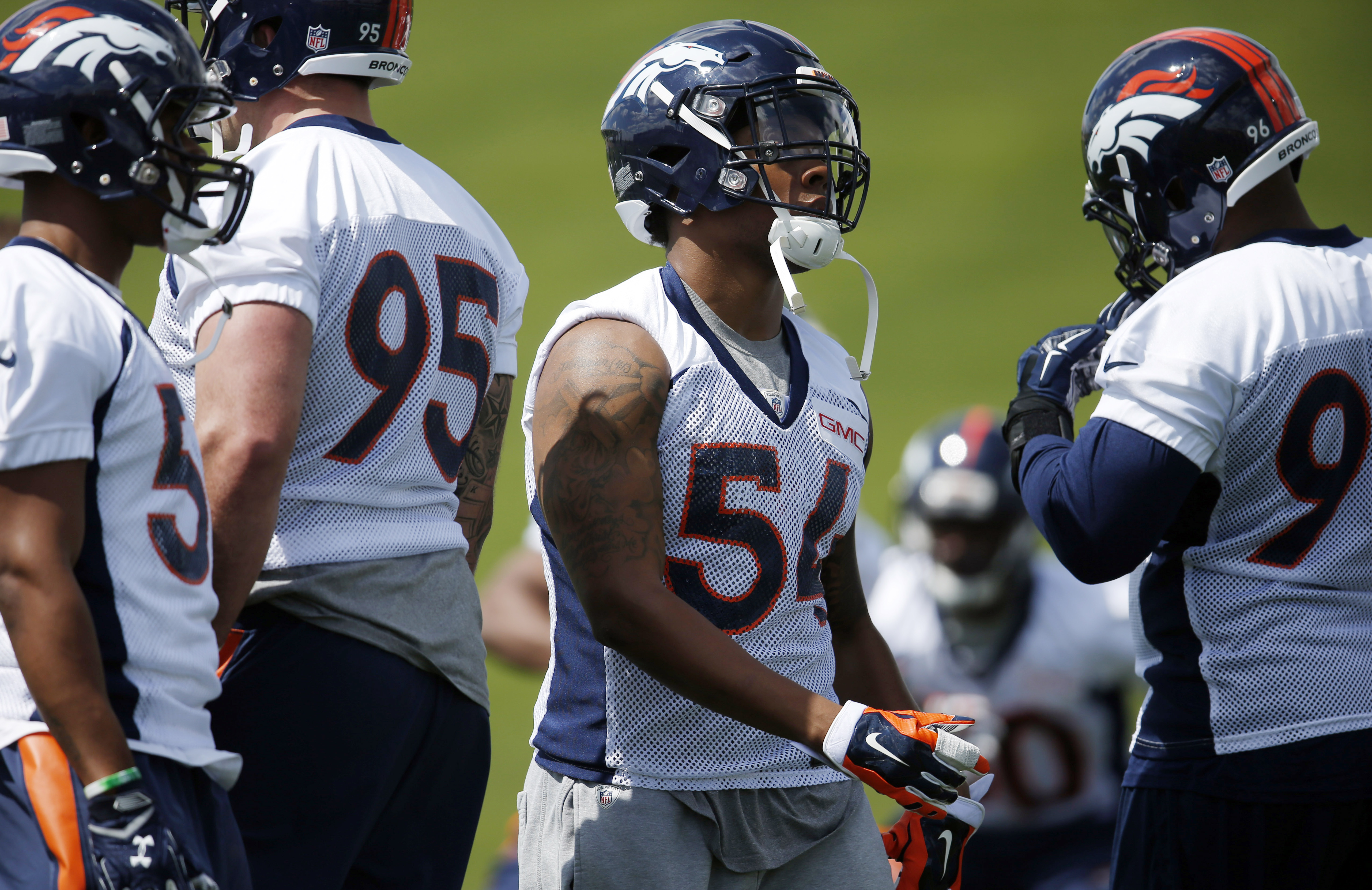 FILE - In this Tuesday, May 24, 2016, file photo, Denver Broncos linebacker Brandon Marshall works out during an NFL football practice at the team's headquarters in Englewood, Colo. Like fellow Broncos linebacker Von Miller, Marshall is awaiting a big con