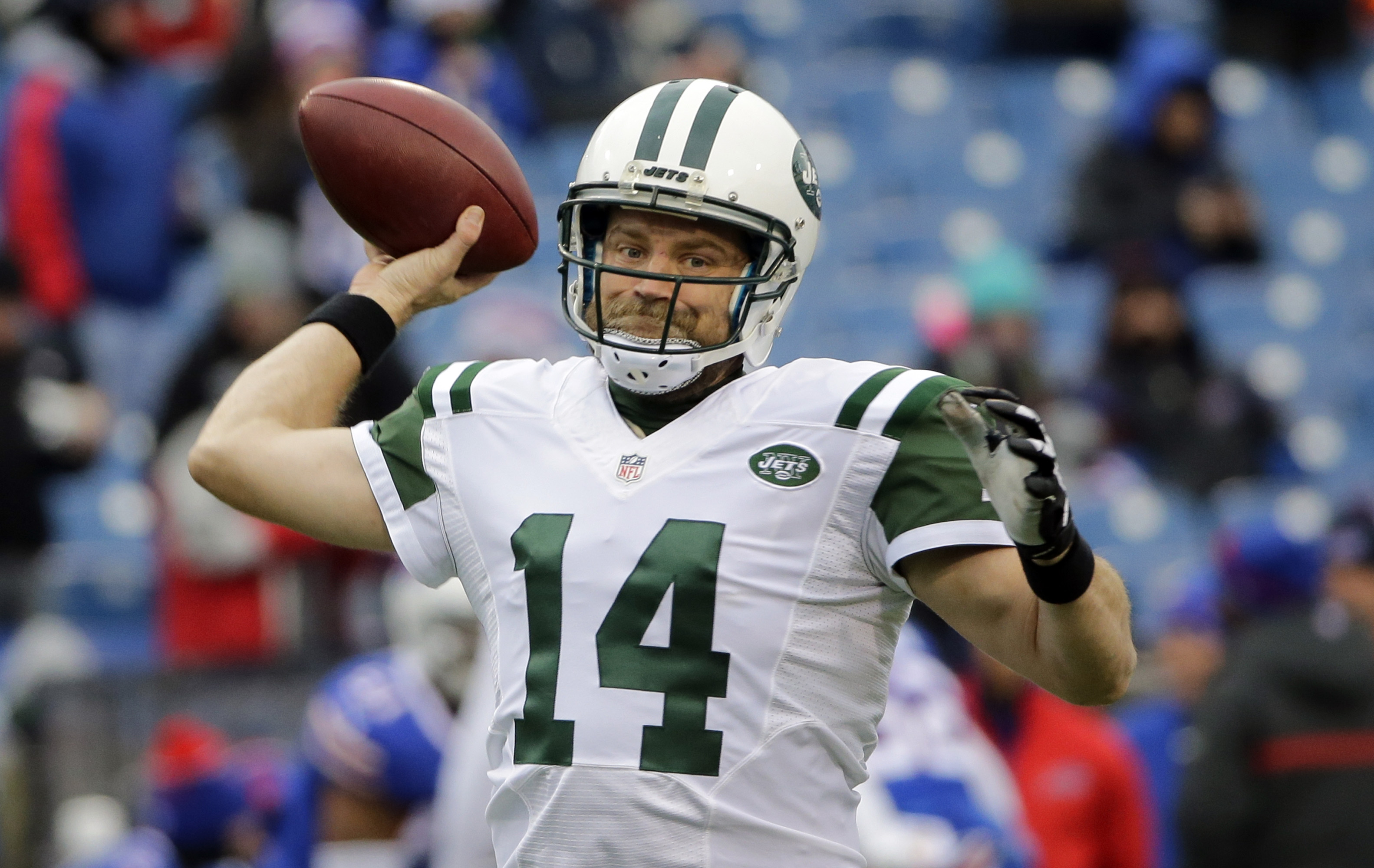 FILE - In this Jan. 3, 2016, file photo, New York Jets quarterback Ryan Fitzpatrick throws a pass before an NFL football game against the Buffalo Bills in Orchard Park, N.Y. A person familiar with the negotiations told The Associated Press on Friday night