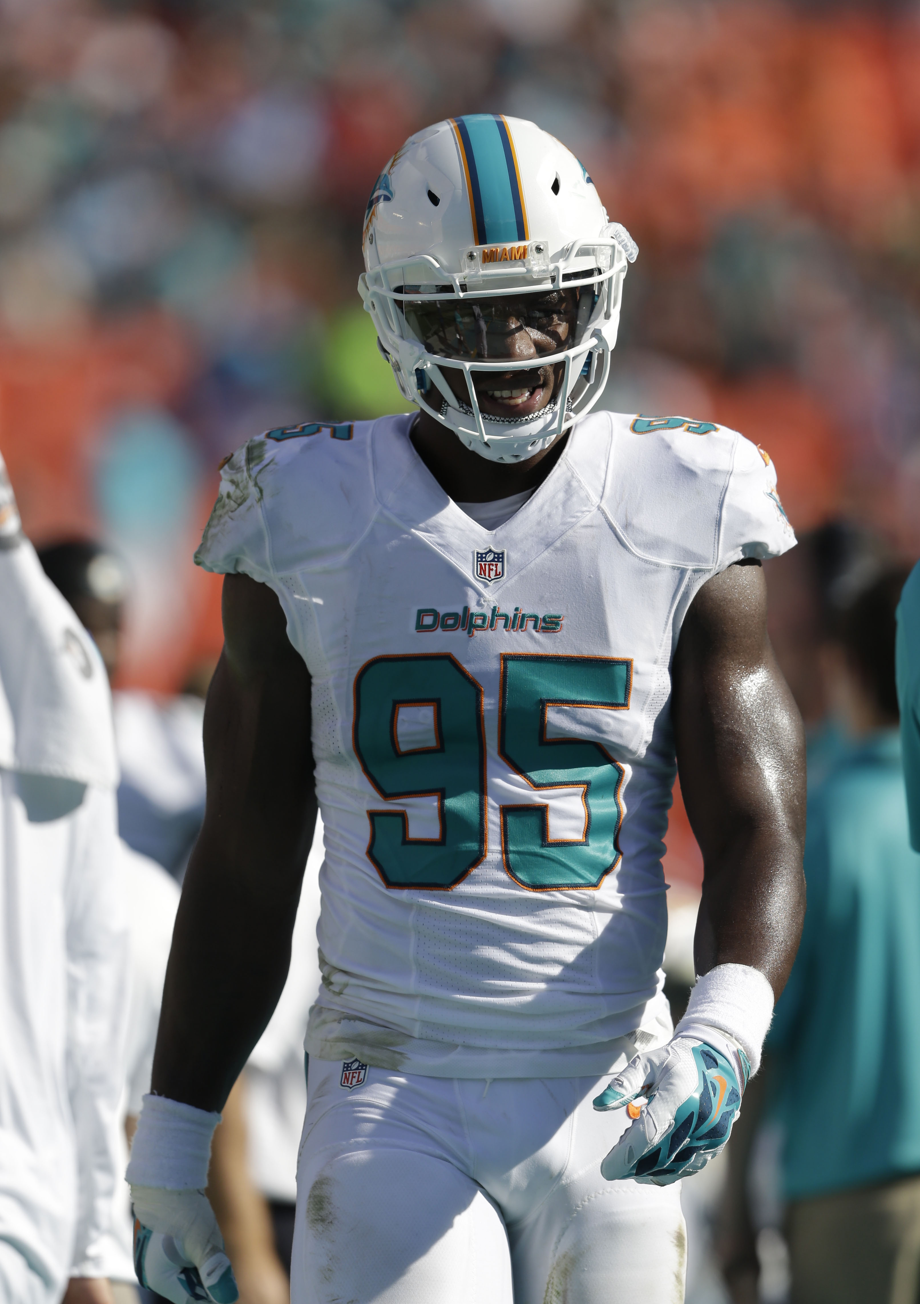 FILE - In this Sunday, Dec. 28, 2014 file photo, Miami Dolphins defensive end Dion Jordan (95) walks the sidelines during the first half of an NFL football game New York Jets in Miami Gardens, Fla. The Dolphins and the NFL announced Tuesday, April 28, 201