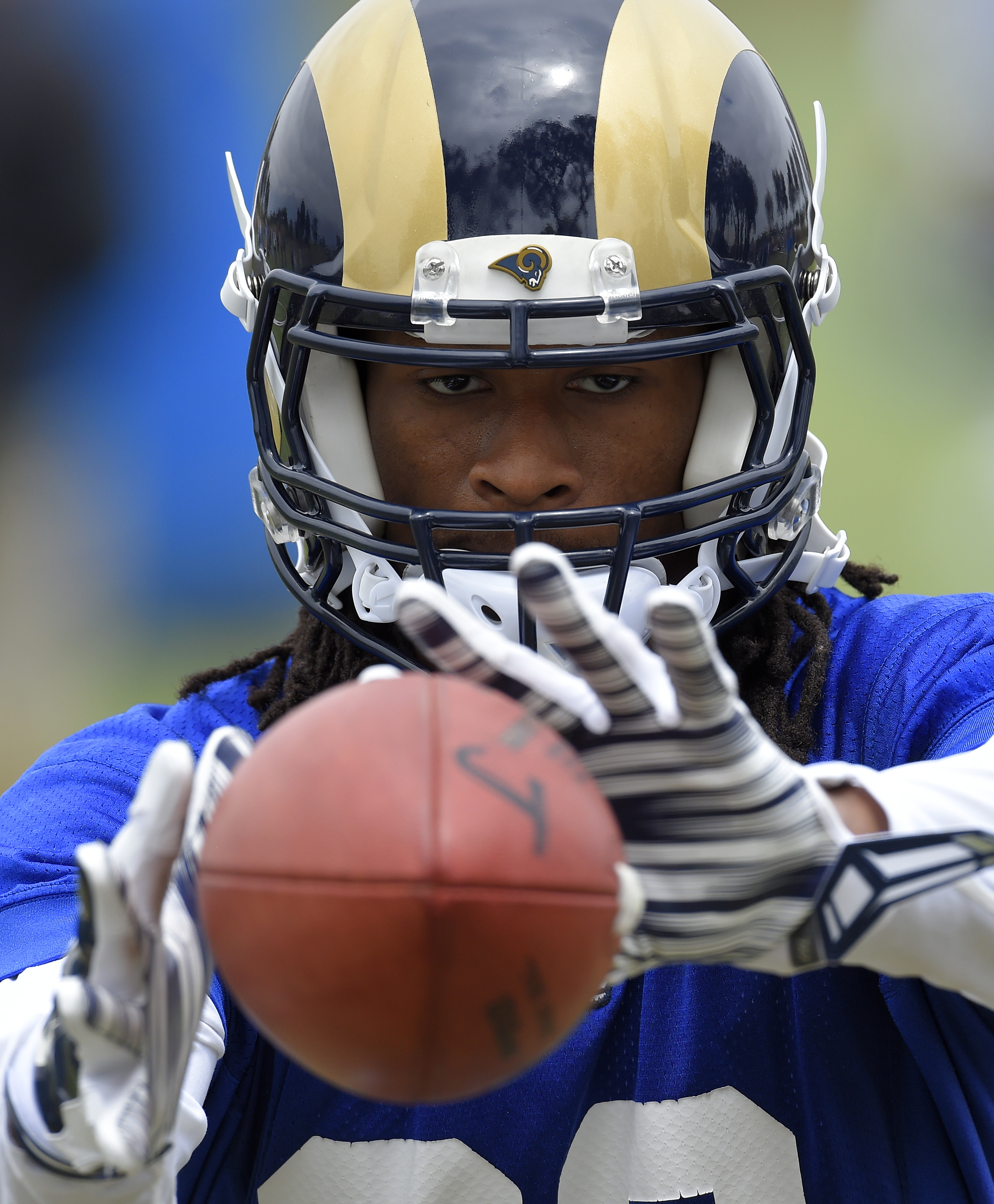 FILE - In this June 1, 2016, file photo, Los Angeles Rams running back Todd Gurley catches passes from a machine during NFL football practice in Oxnard, Calif.  In the first few months since the Rams went Hollywood, Todd Gurley has already landed commerci