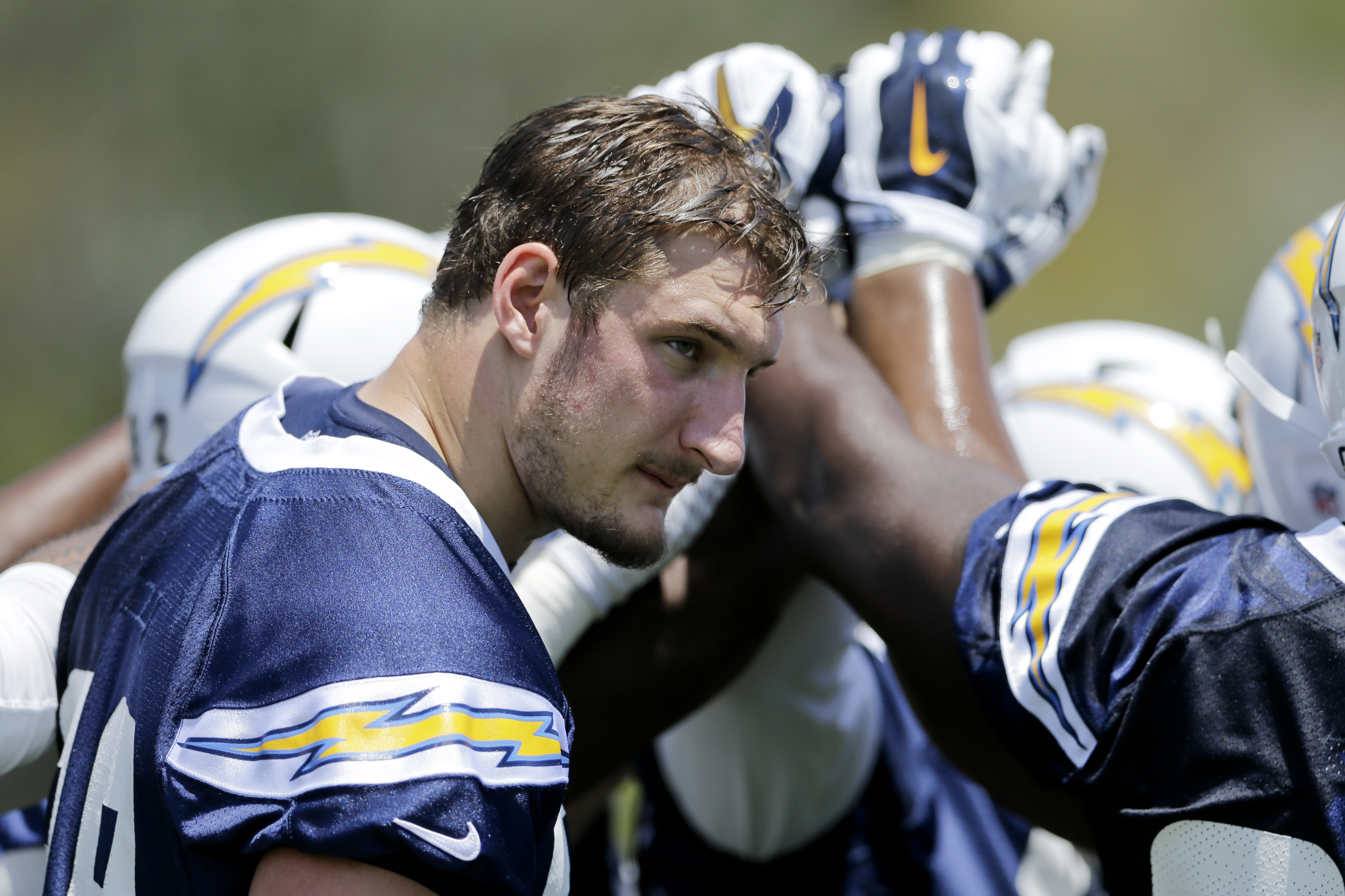 San Diego Chargers rookie defensive end Joey Bosa touches hands with others on the Chargers defense during an NFL football practice Monday, June 6, 2016, in San Diego. (AP Photo/Gregory Bull)