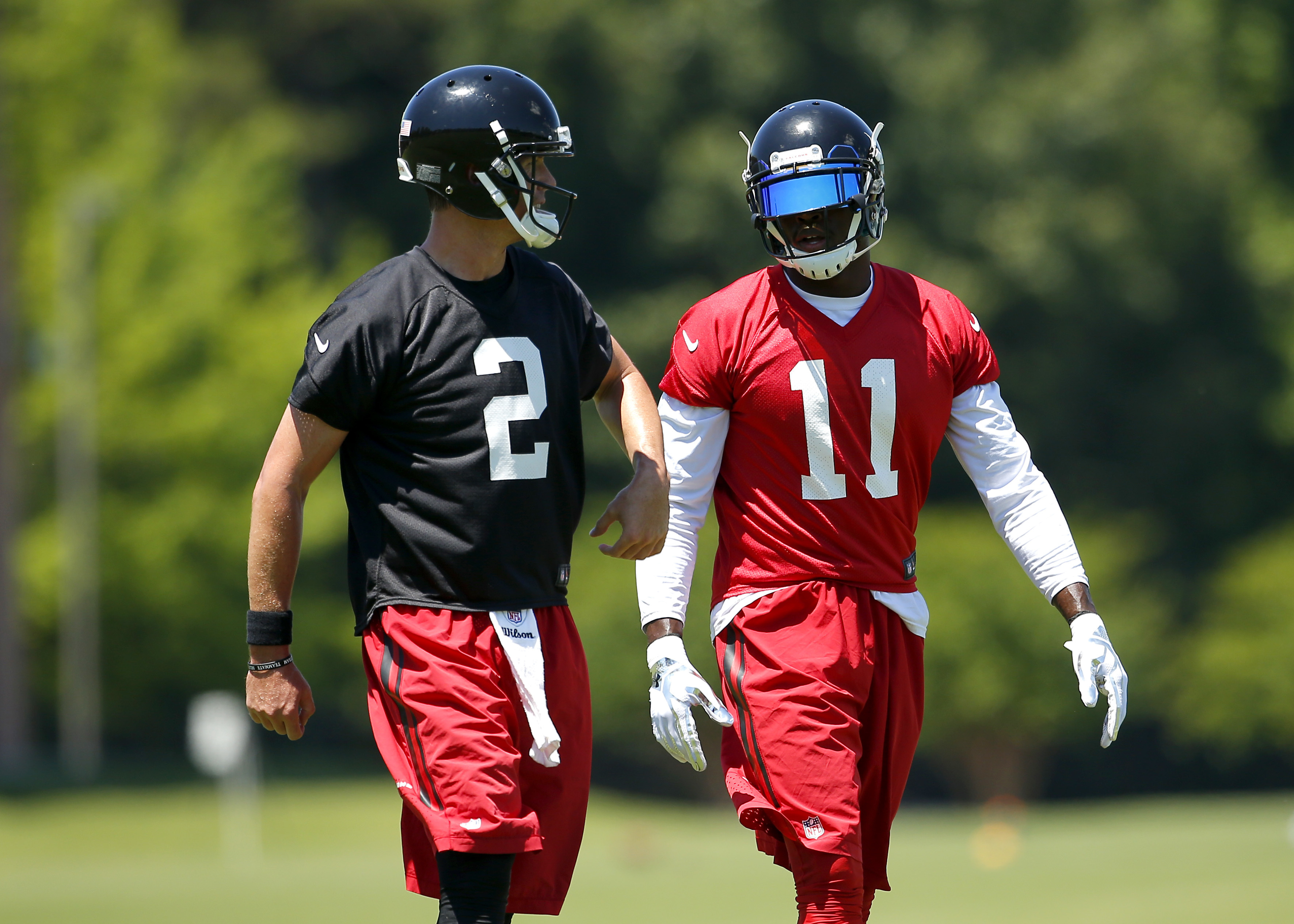 Atlanta Falcons quarterback Matt Ryan (2) speaks with wide receiver Julio Jones (11) during an NFL football practice in Flowery Branch, Ga. Tuesday, June 7, 2016. (AP Photo/Todd Kirkland)