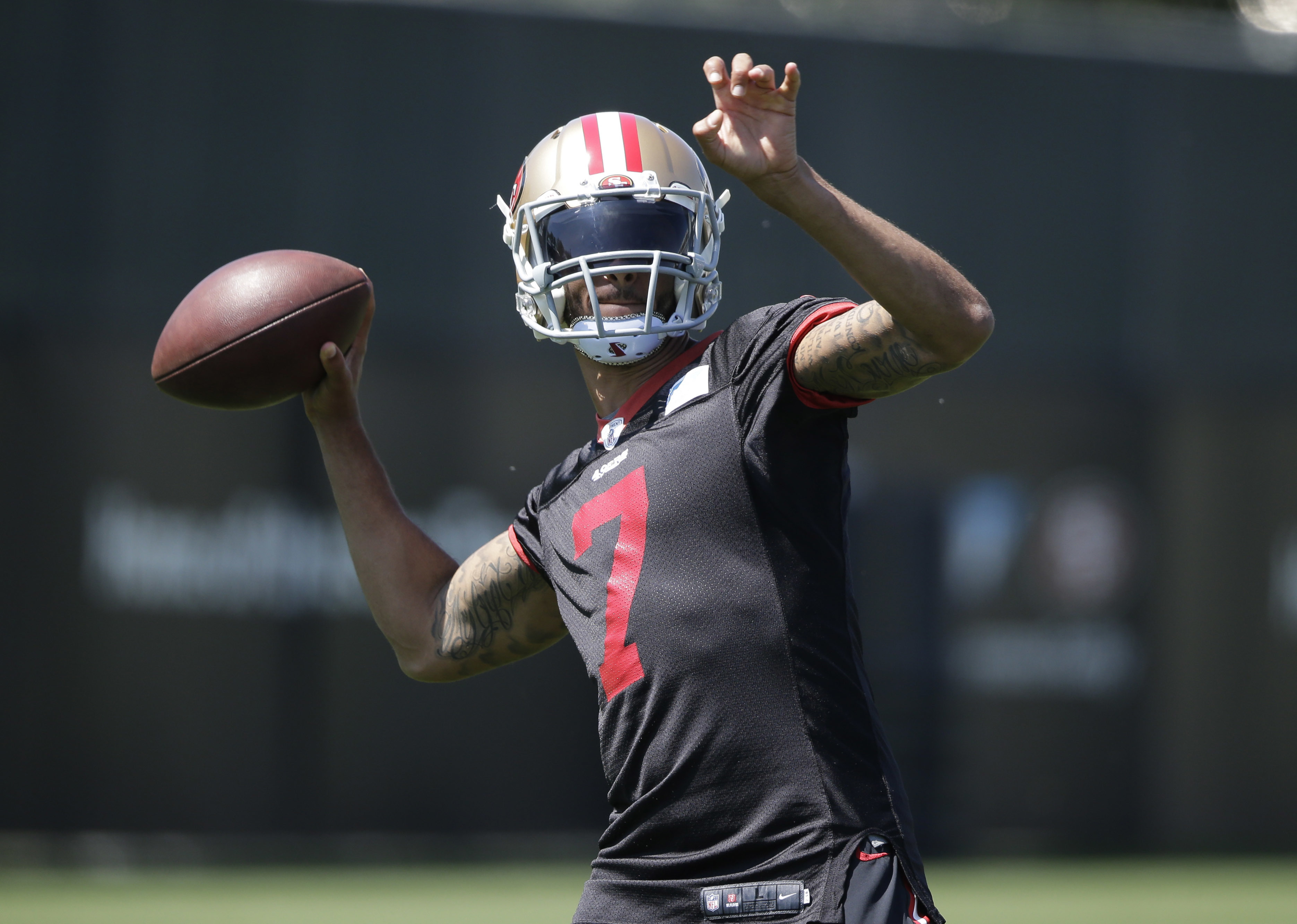 San Francisco 49ers quarterback Colin Kaepernick (7) throws during an NFL football practice Tuesday, June 7, 2016, in Santa Clara, Calif. (AP Photo/Marcio Jose Sanchez)
