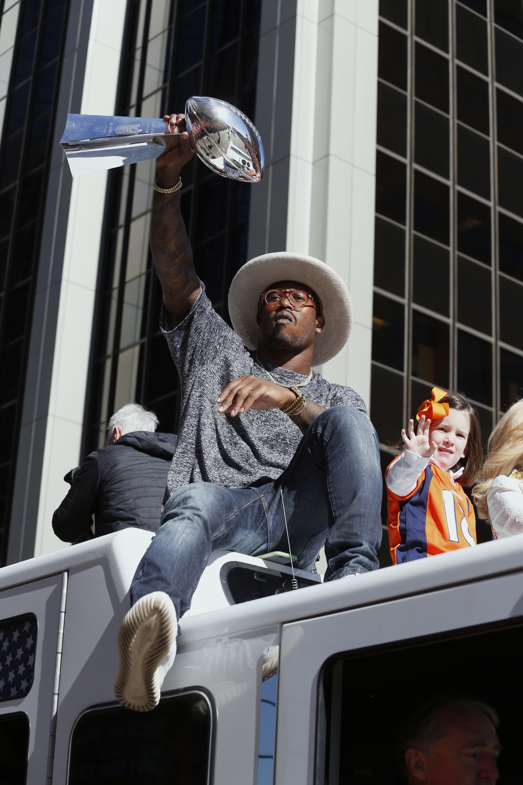 FILE - In this Tuesday, Feb. 9, 2016 file photo, Denver Broncos Super Bowl MVP defensive back Von Miller hoists the Lombardi Trophy high for the fans to see during a Super Bowl victory parade in Denver. The Super Bowl champions reconvened Monday, April 18
