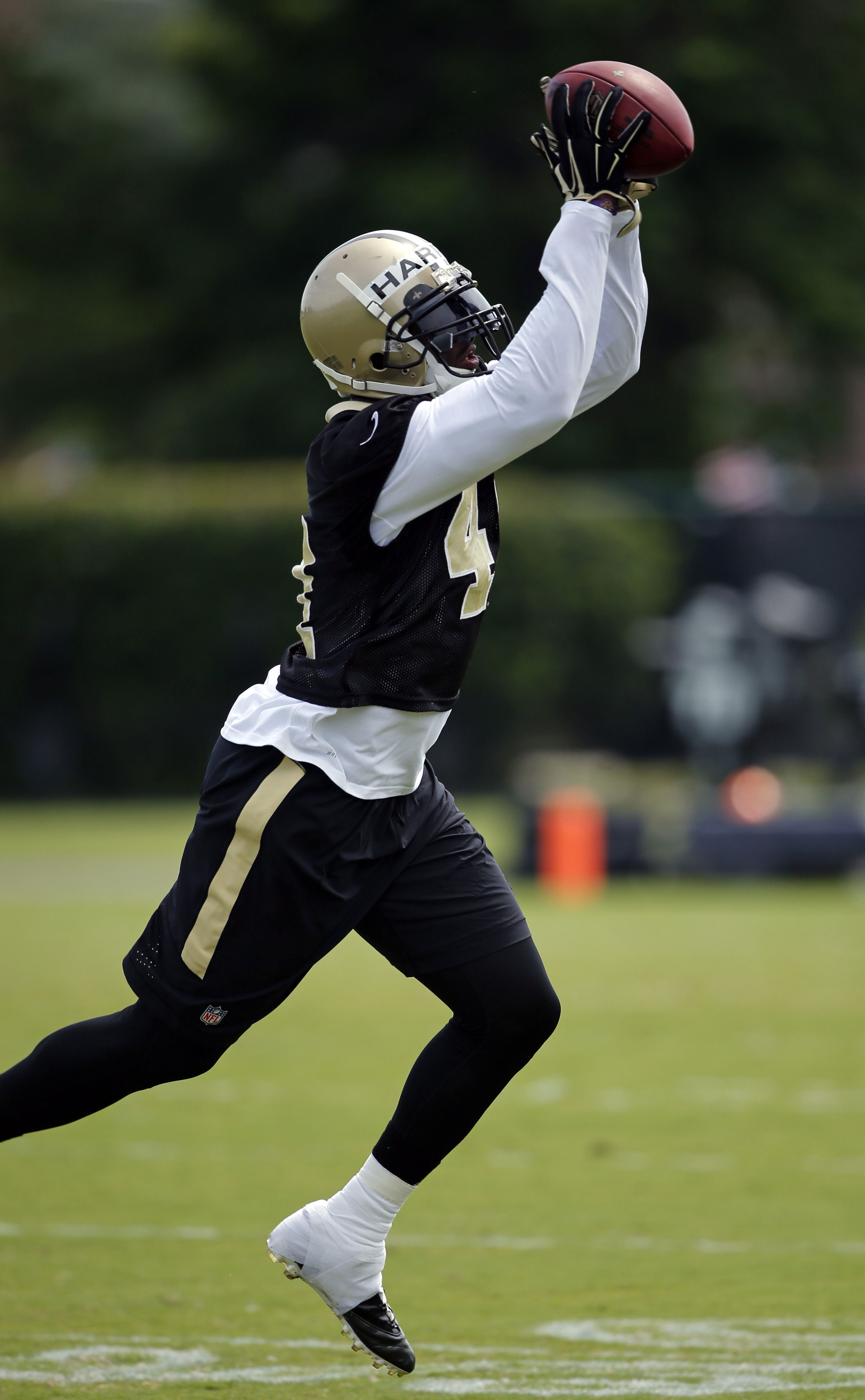 New Orleans Saints safety Roman Harper (41) goes through drills during an NFL football practice in Metairie, La., Thursday, June 9, 2016. (AP Photo/Gerald Herbert)