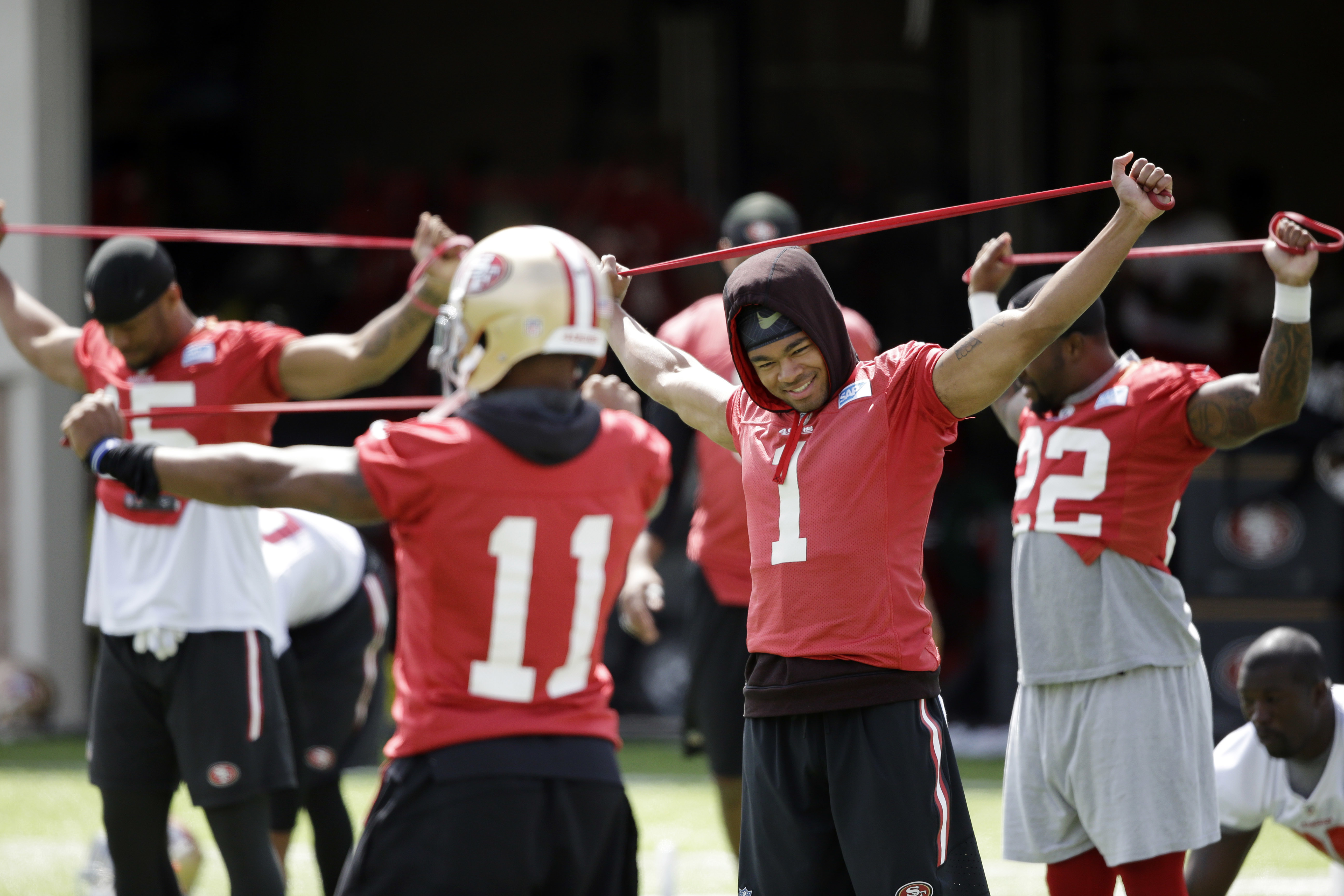 San Francisco 49ers players stretch during an NFL football practice Thursday, June 9, 2016, in Santa Clara, Calif. (AP Photo/Marcio Jose Sanchez)