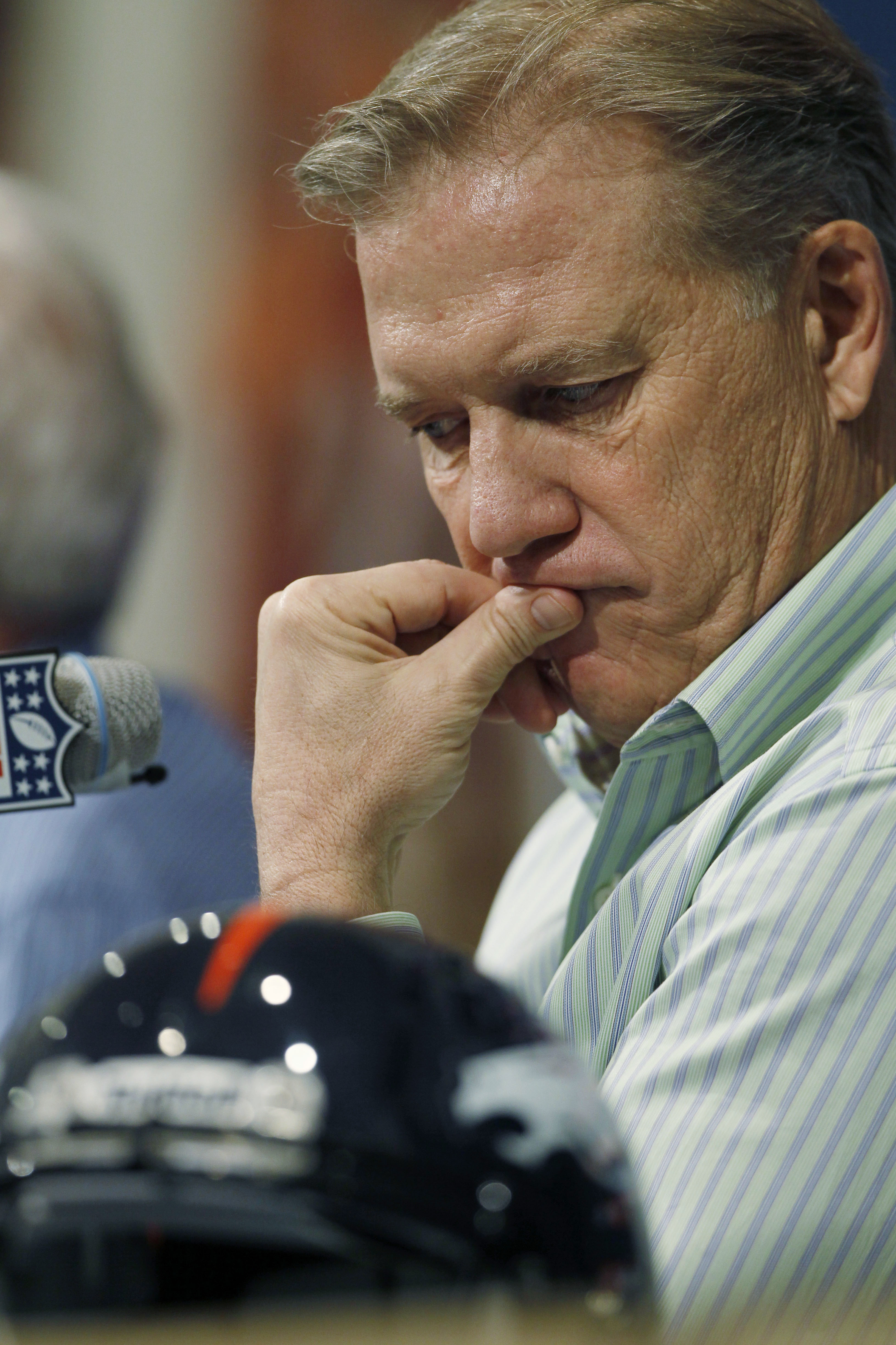 FILE - In this Monday, Jan. 14, 2013, file photo, John Elway, the Denver Broncos executive vice president of football operations, considers a question about his team's AFC Playoff loss to the Baltimore Ravens from reporters during a news conference in the