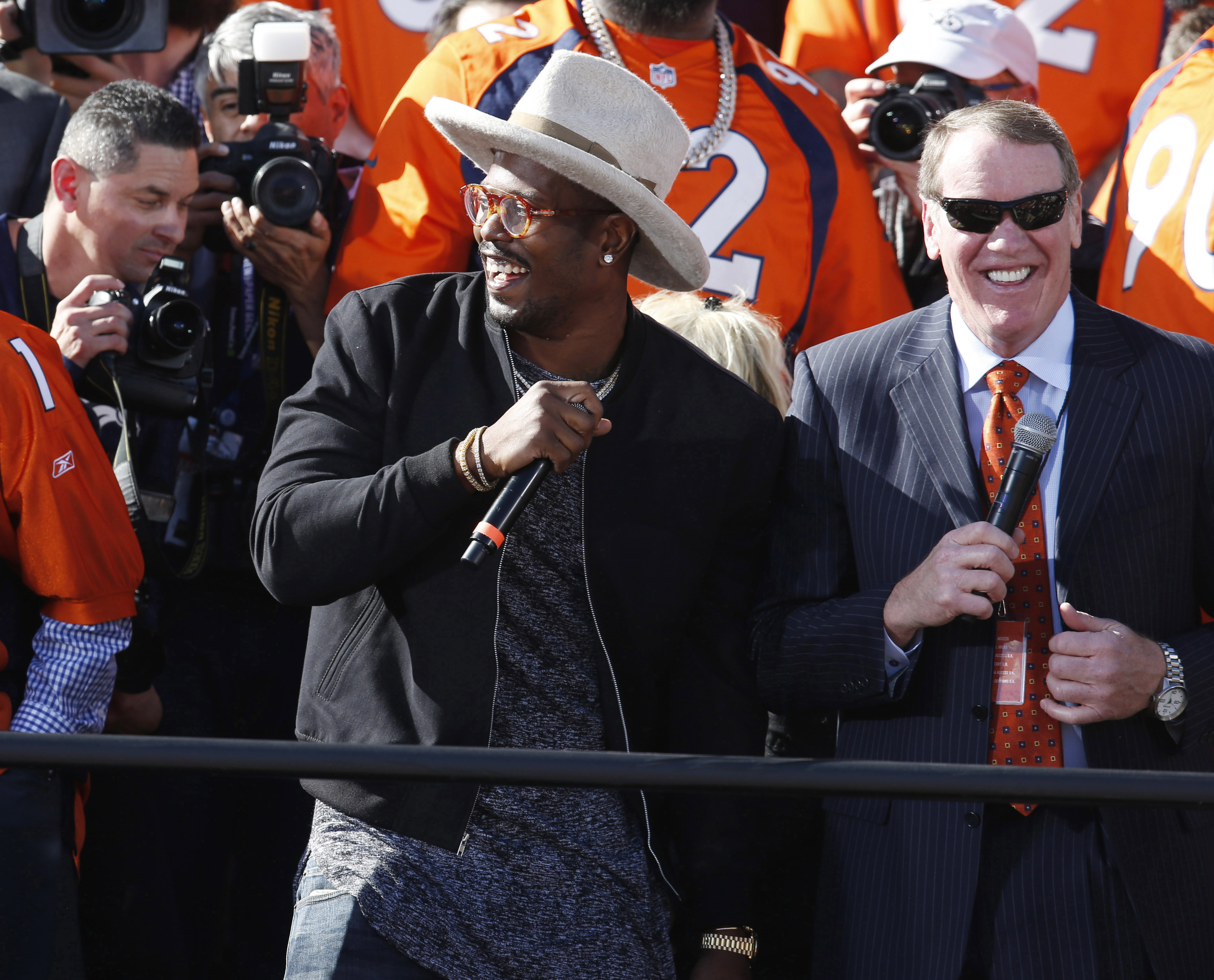 FILE - In this Tuesday, Feb. 9, 2016, file photo, Denver Broncos outside linebacker Von Miller, center, jokes with teammates at a rally following a parade through downtown Denver. Miller, the Super Bowl 50 MVP, and the Broncos have reached an impasse in c
