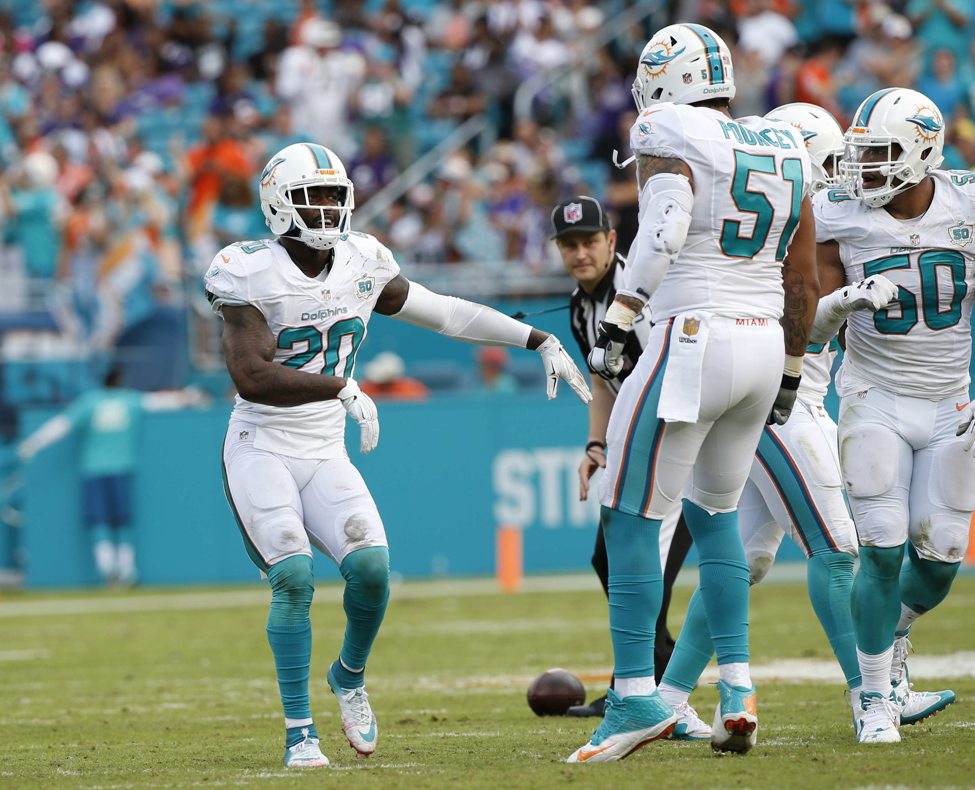 Miami Dolphins strong safety Reshad Jones (20) dances after intercepting the ball during the first half of an NFL football game against the Baltimore Ravens, Sunday, Dec. 6, 2015, in Miami Gardens, Fla.  (AP Photo/Wilfredo Lee)