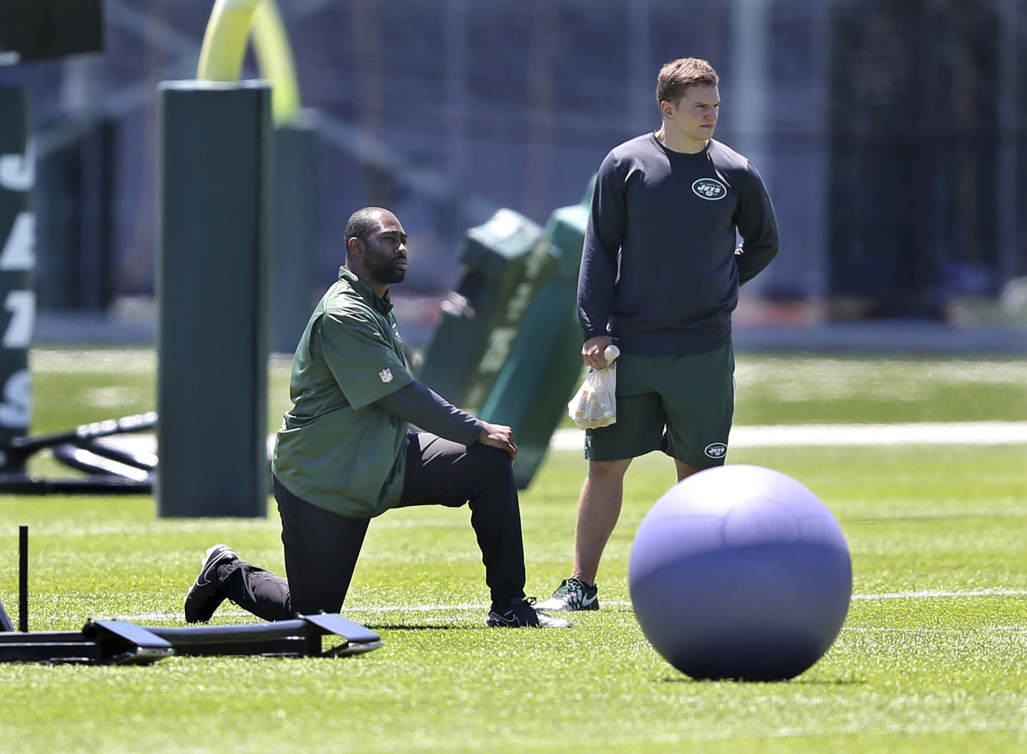 New York Jets cornerback Darrelle Revis, left, stretches during football practice Tuesday, June 14, 2016, in Florham Park, N.J. (AP Photo/Mel Evans)