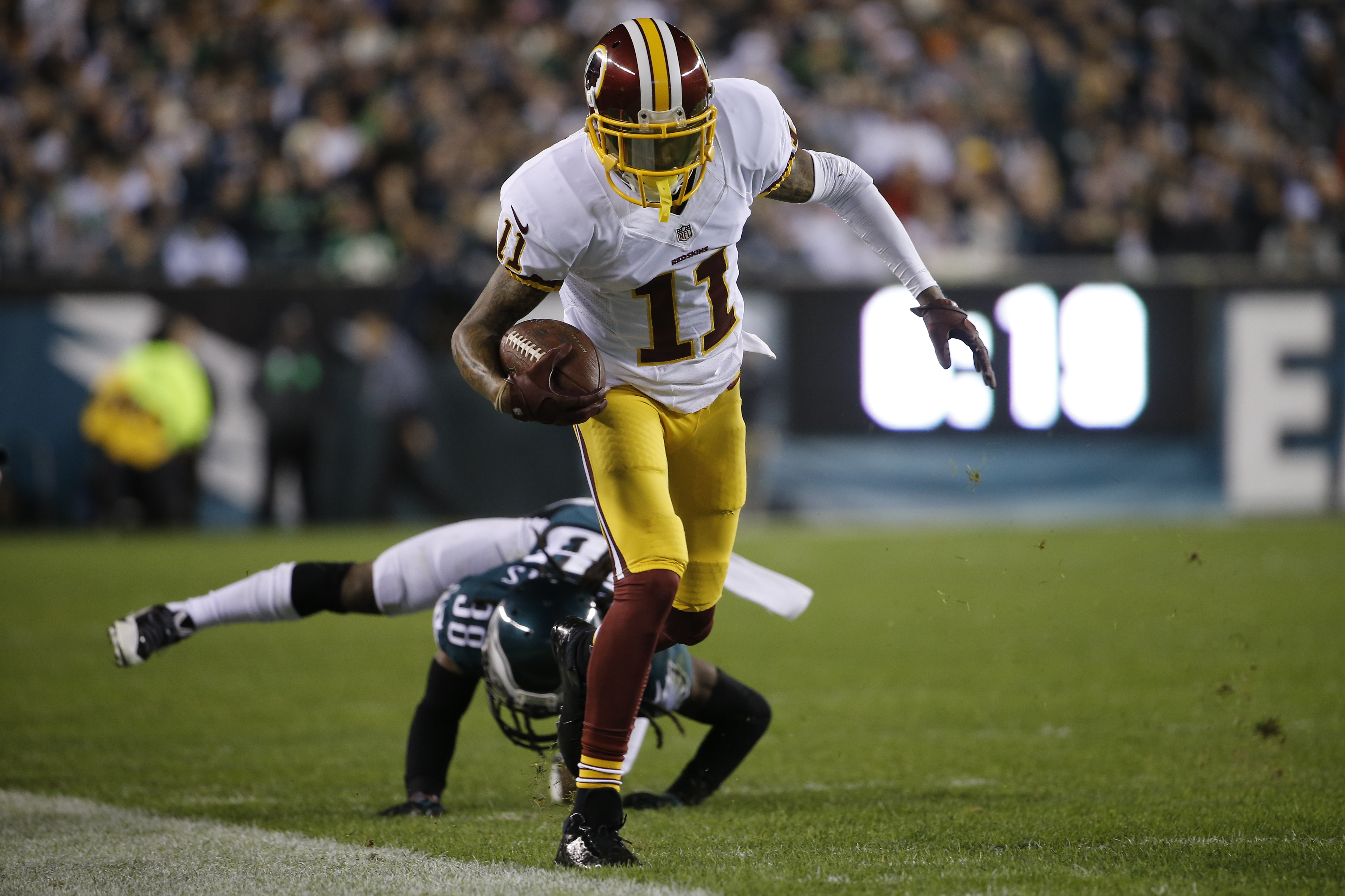 In this photo taken Dec. 26, 2015, Washington Redskins' DeSean Jackson runs after a catch in the first half of an NFL football game against the Philadelphia Eagles in Philadelphia. Jackson is keeping quiet and letting his play do the talking at Washington