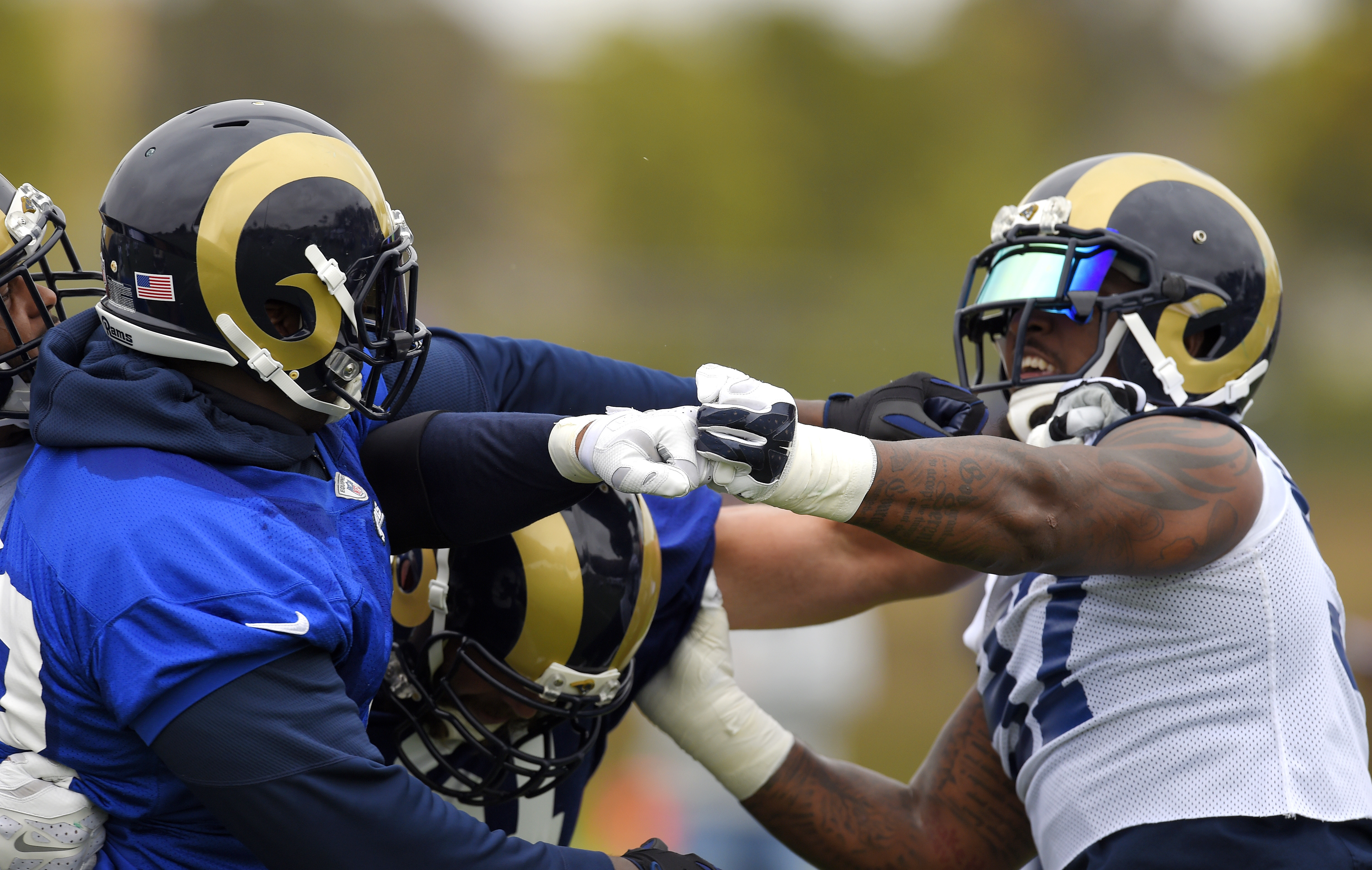 Los Angeles Rams tackle Greg Robinson, left, and defensive end Eugene Sims scuffle during NFL football practice, Tuesday, June 14, 2016, in Oxnard, Calif. (AP Photo/Mark J. Terrill)