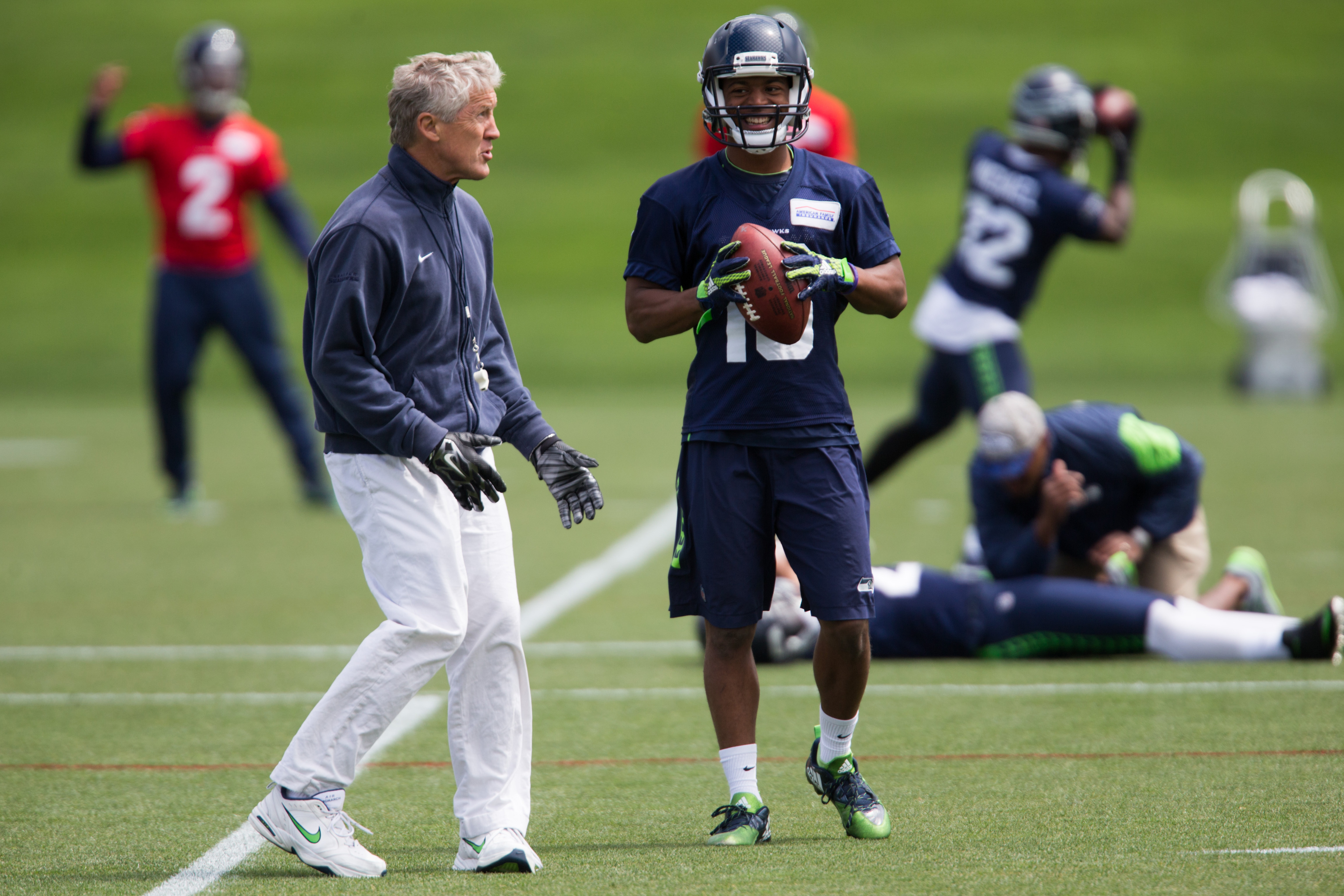 Seahawks head coach Pete Carroll meets with wide receiver Tyler Lockett during NFL football practice, Tuesday, June 14, 2016 at Virginia Mason Athletic Center in Renton, Wash. (Grant Hindsley/seattlepi.com via AP) MAGS OUT; NO SALES; SEATTLE TIMES OUT; TV