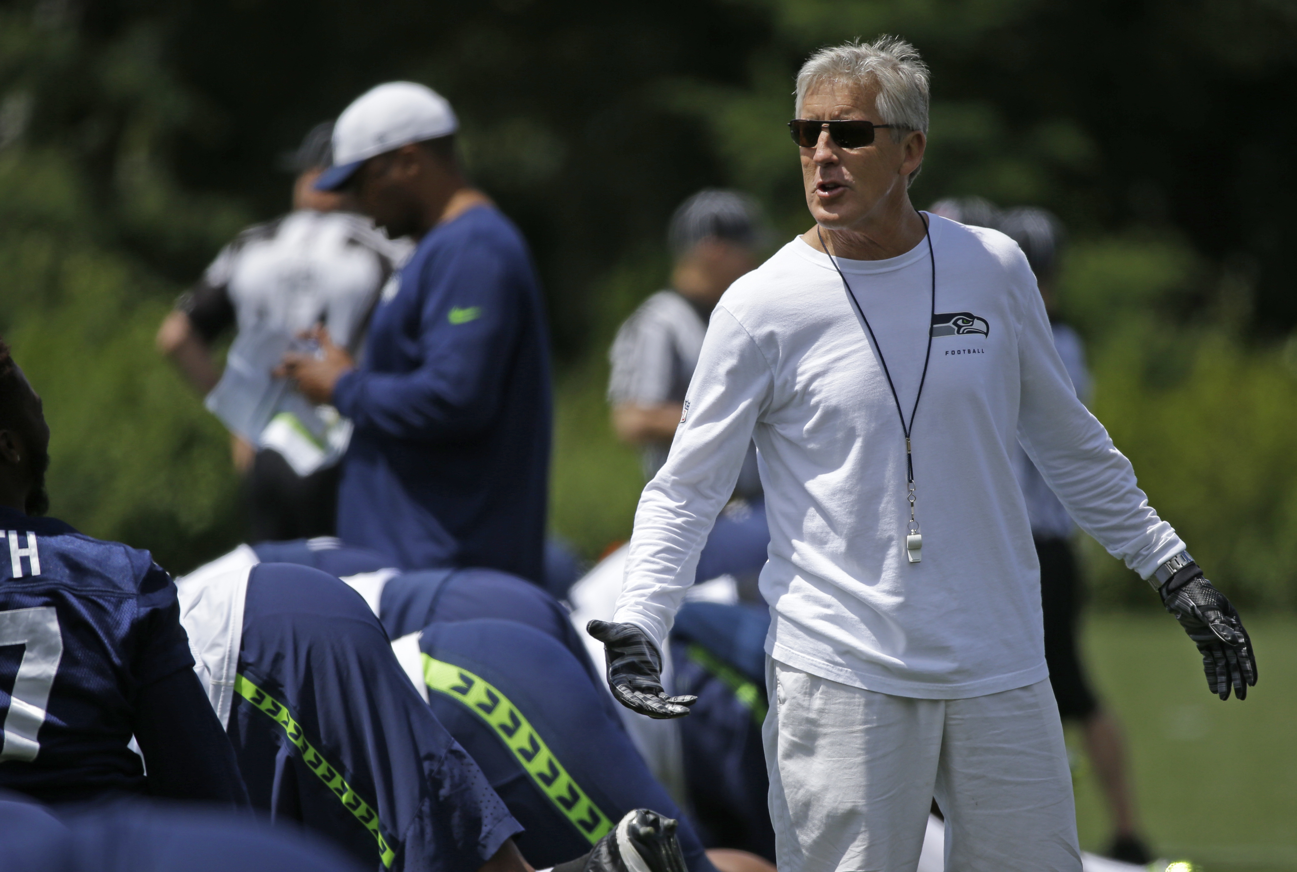 Seattle Seahawks head coach Pete Carroll looks on as players stretch before NFL football practice, Wednesday, June 15, 2016, in Renton, Wash. (AP Photo/Ted S. Warren)