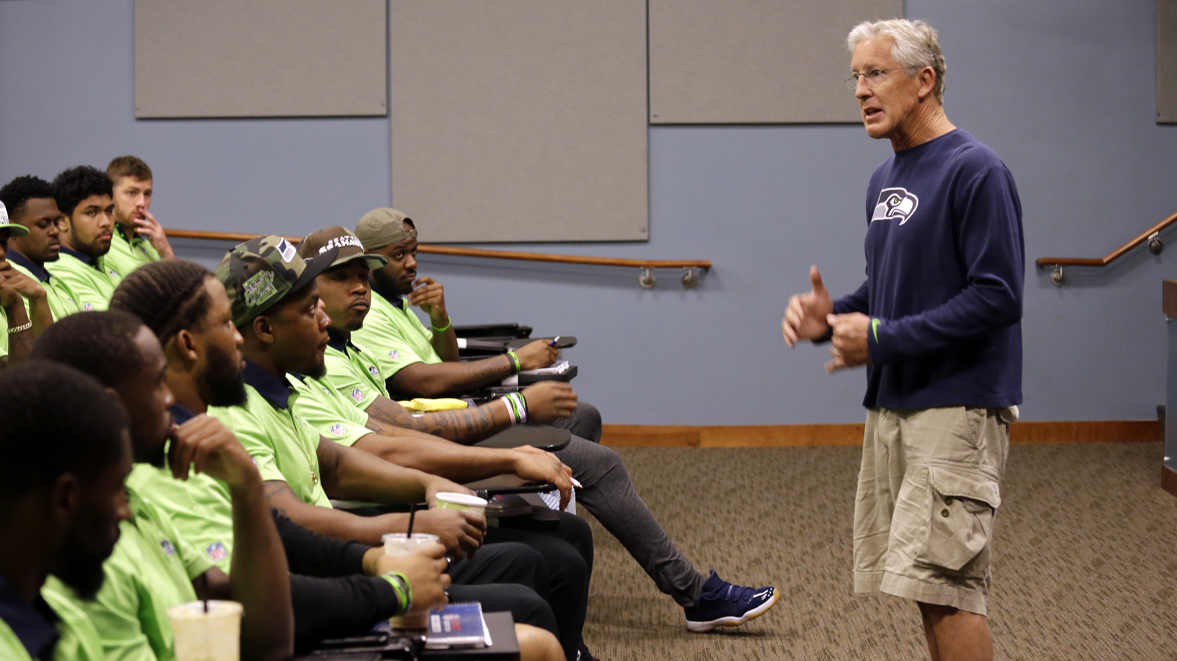 Seattle Seahawks coach Pete Carroll talks with rookies at the football team's training camp Monday, June 20, 2016, in Renton, Wash. The team is holding a rookie symposium for the new players to give them information about the NFL. (AP Photo/Elaine Thompso