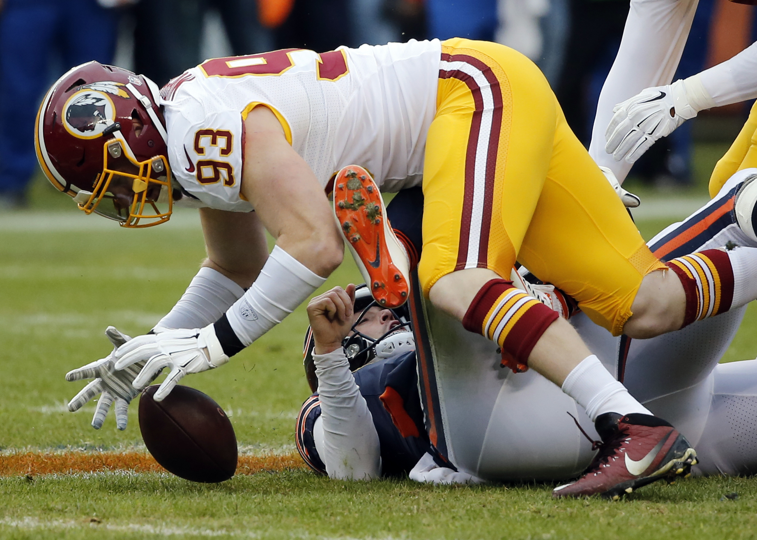 FILE - In this Dec. 13, 2015 file photo, Washington Redskins outside linebacker Trent Murphy (93) recovers a fumble after tackling Chicago Bears quarterback Jay Cutler (6) for a sack during the first half of an NFL football game in Chicago.  NFL teams are