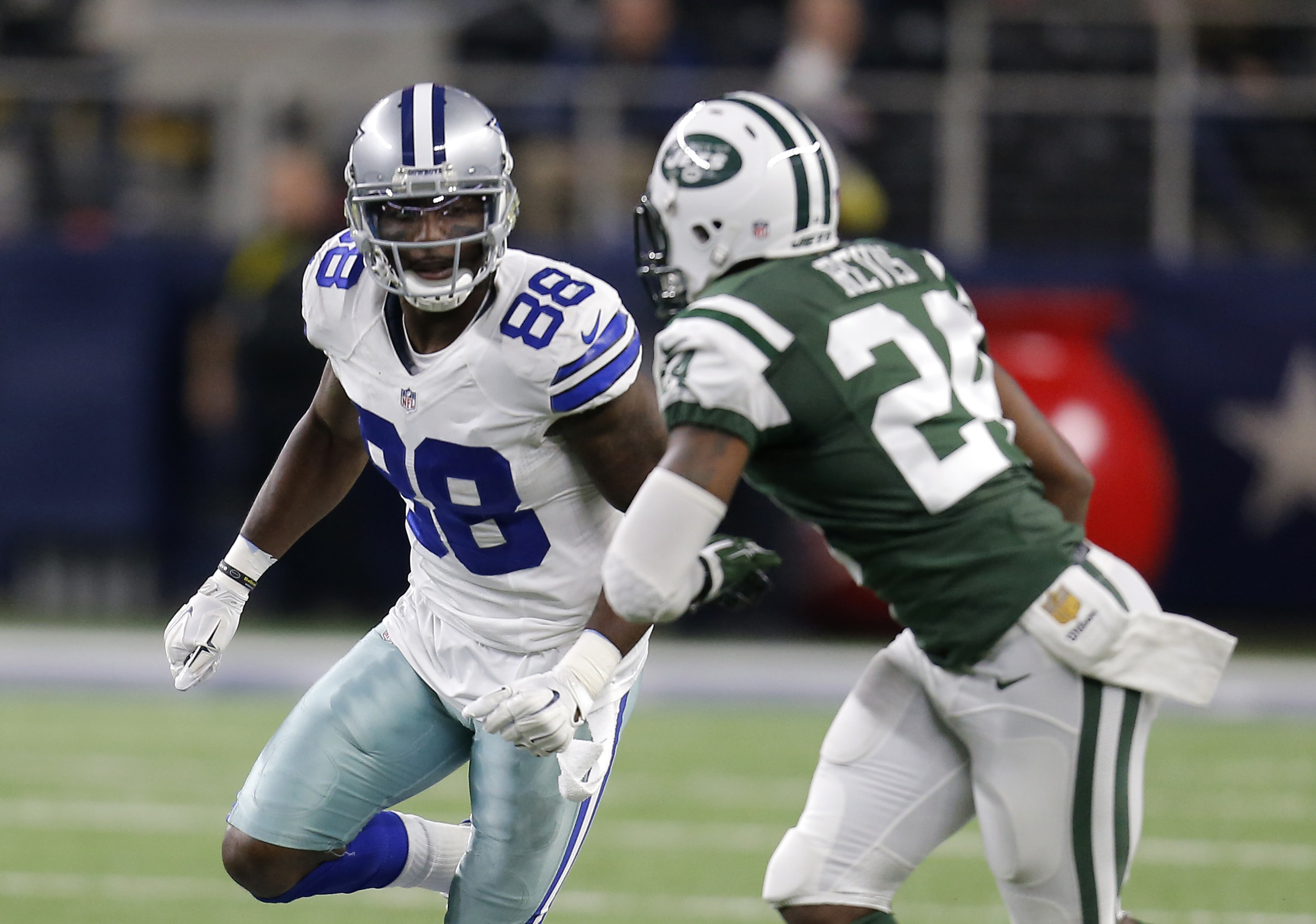 FILE - In this Saturday, Dec. 19, 2015 file photo, Dallas Cowboys wide receiver Dez Bryant (88) runs a route against New York Jets cornerback Darrelle Revis (24) in the first half of an NFL football game in Arlington, Texas. Dez Bryant faces a lawsuit fro