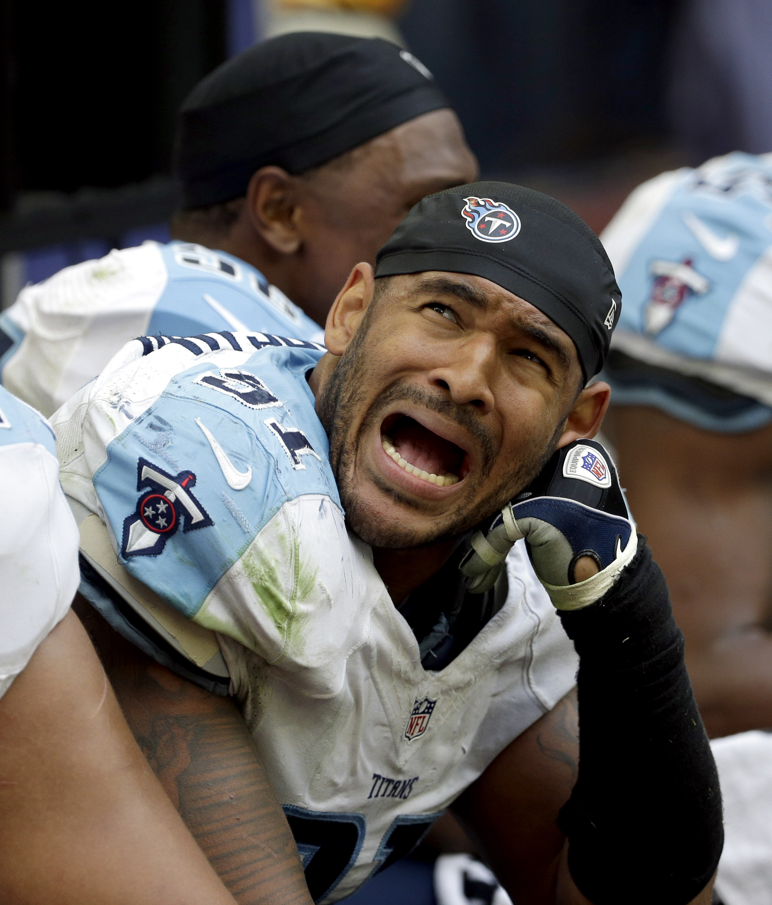 FILE - In this Nov. 30, 2014 file photo, Tennessee Titans outside linebacker Derrick Morgan reacts as the receiving yards for Houston Texans wide receiver DeAndre Hopkins are announced and posted on the scoreboard during the second half of an NFL football