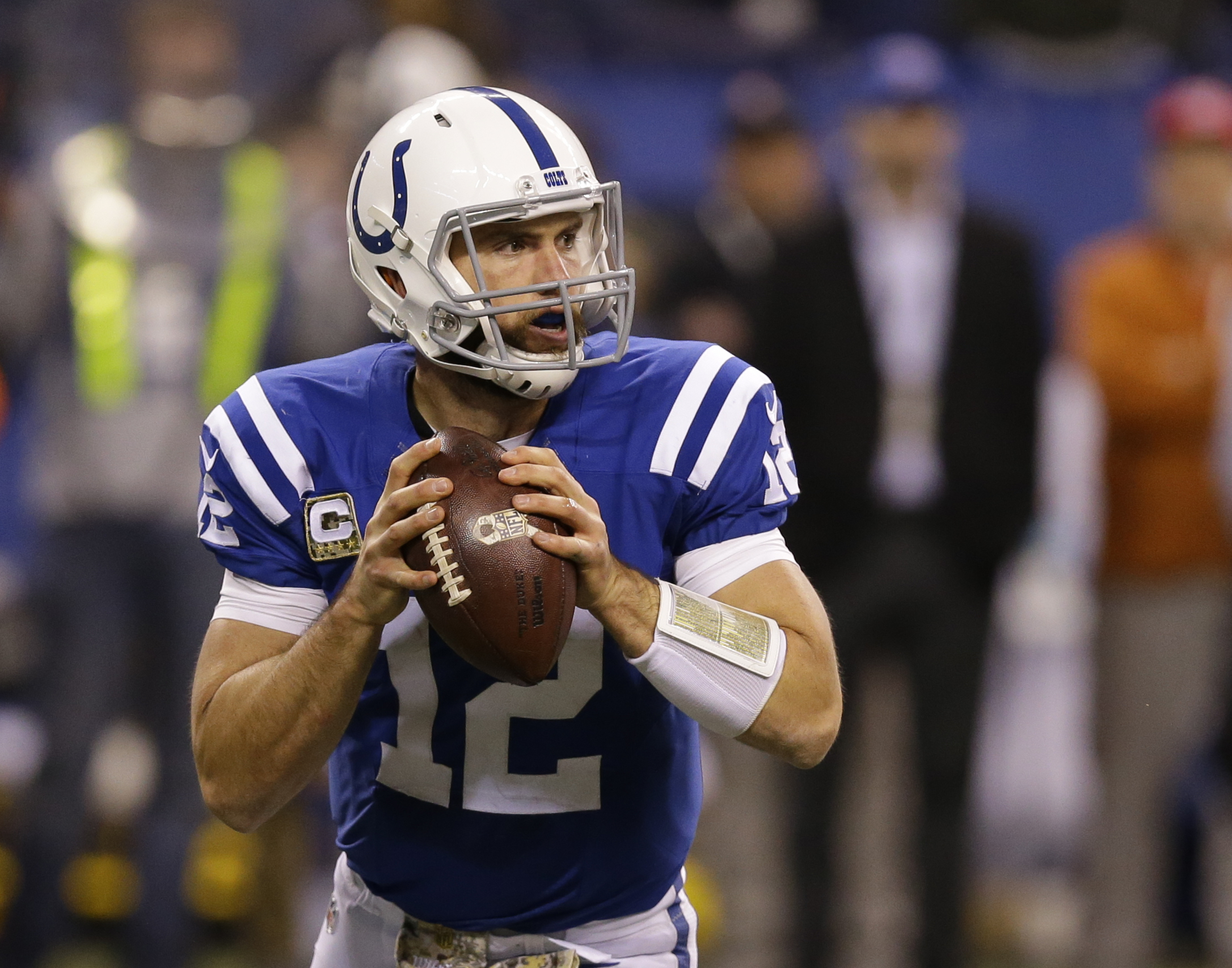 FILE - In this Nov. 8, 2015, file photo, Indianapolis Colts' Andrew Luck (12) looks to throw during the second half of an NFL football game against the Denver Broncos, in Indianapolis. Luck has signed a new contract with the Indianapolis Colts that covers