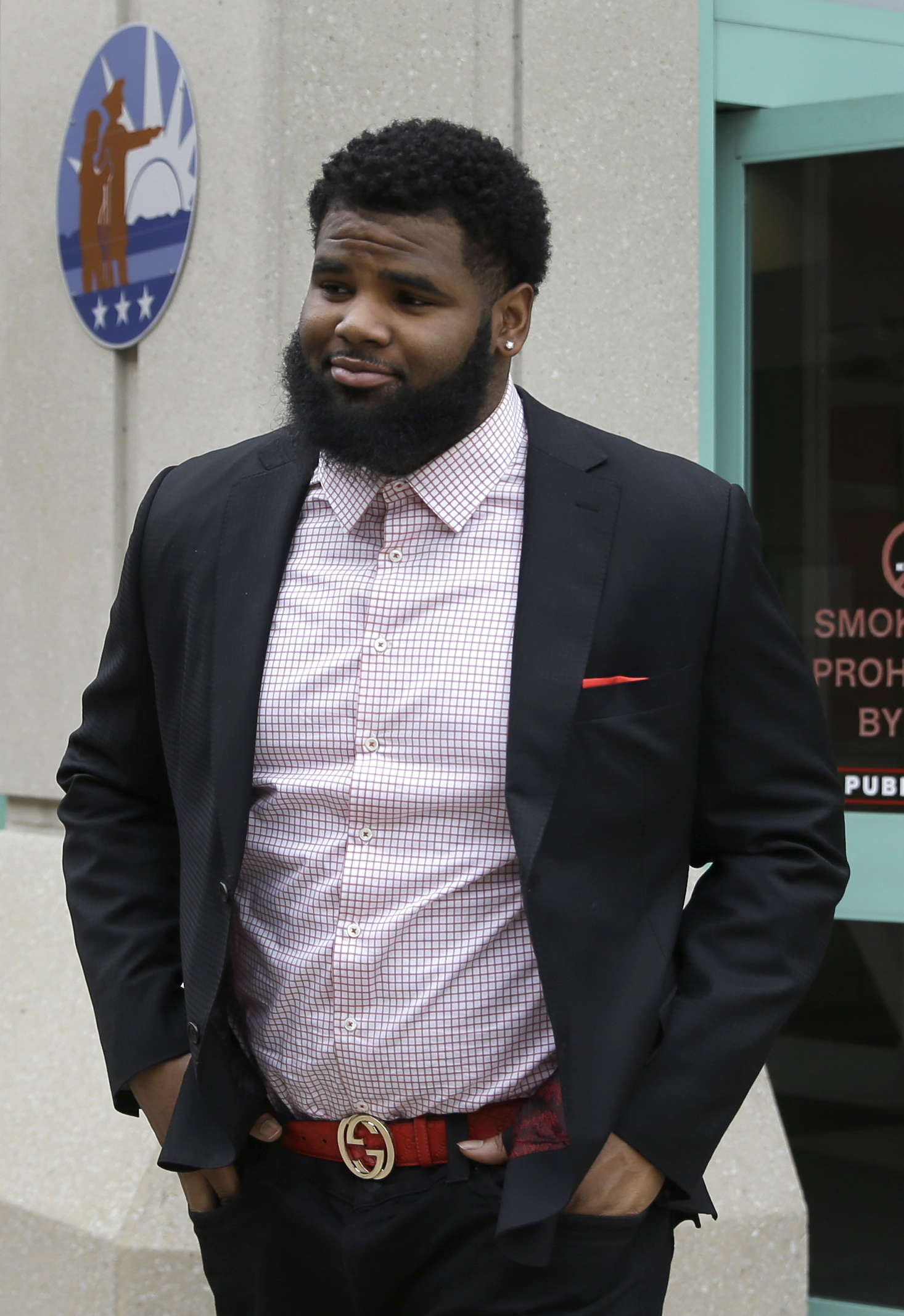 New York Jets NFL football player Sheldon Richardson walks out of the St. Charles County Courthouse, Tuesday, Jan. 26, 2016, in St. Charles, Mo., after pleading guilty to reduced charges connected to a recent high-speed police chase.  Richardson was sente