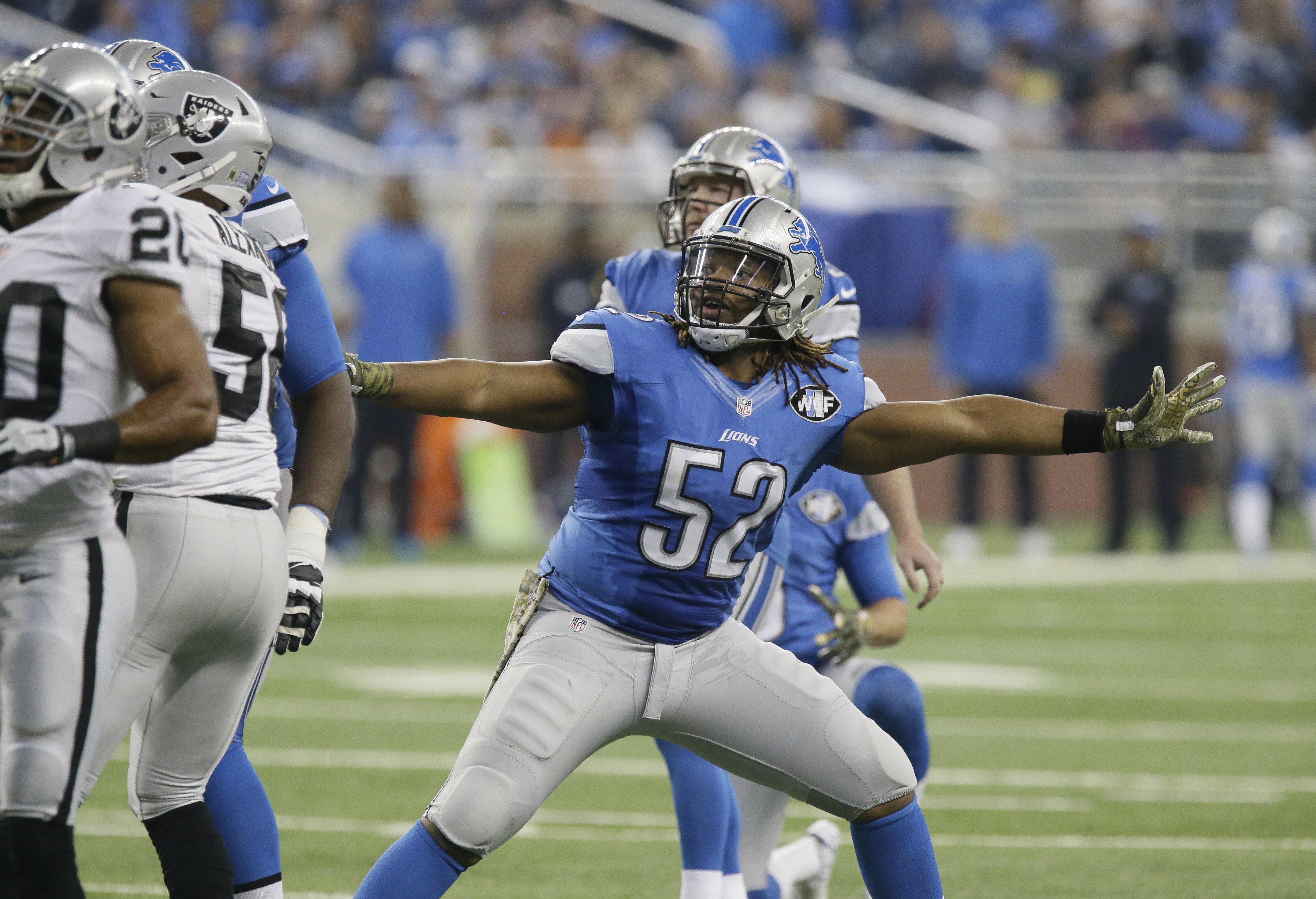 Detroit Lions defensive end Darryl Tapp (52) watches as the field goal by kicker Matt Prater clears the posts during the first half of an NFL football game against the Oakland Raiders, Sunday, Nov. 22, 2015, in Detroit. (AP Photo/Duane Burleson)