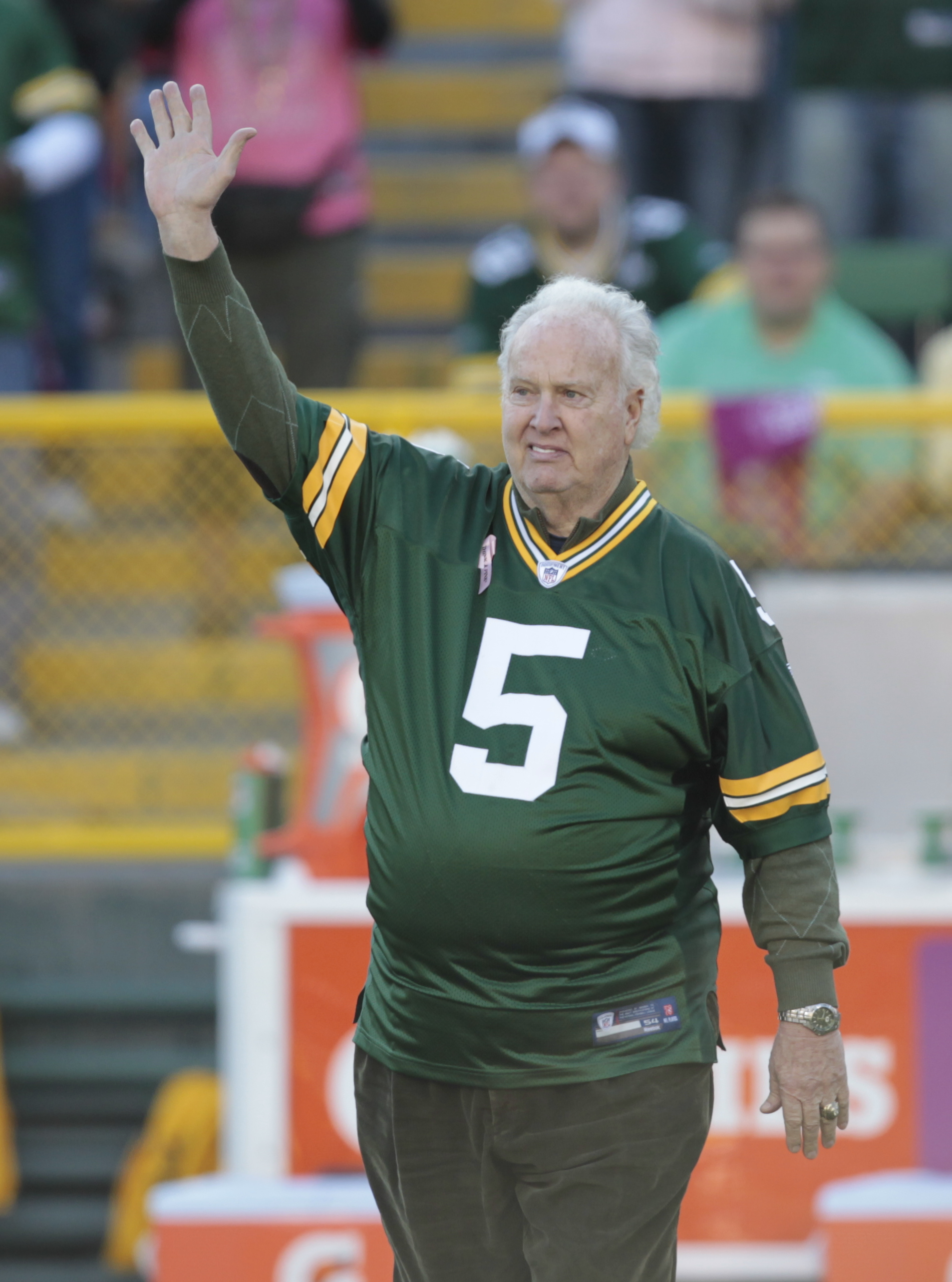 Former Green Bay Packer Paul Hornung waved to the crowd during the second half of an NFL football game between the Green Bay Packers and Denver Broncos Sunday, Oct. 2, 2011, in Green Bay, Wis. (AP Photo/Mike Roemer)