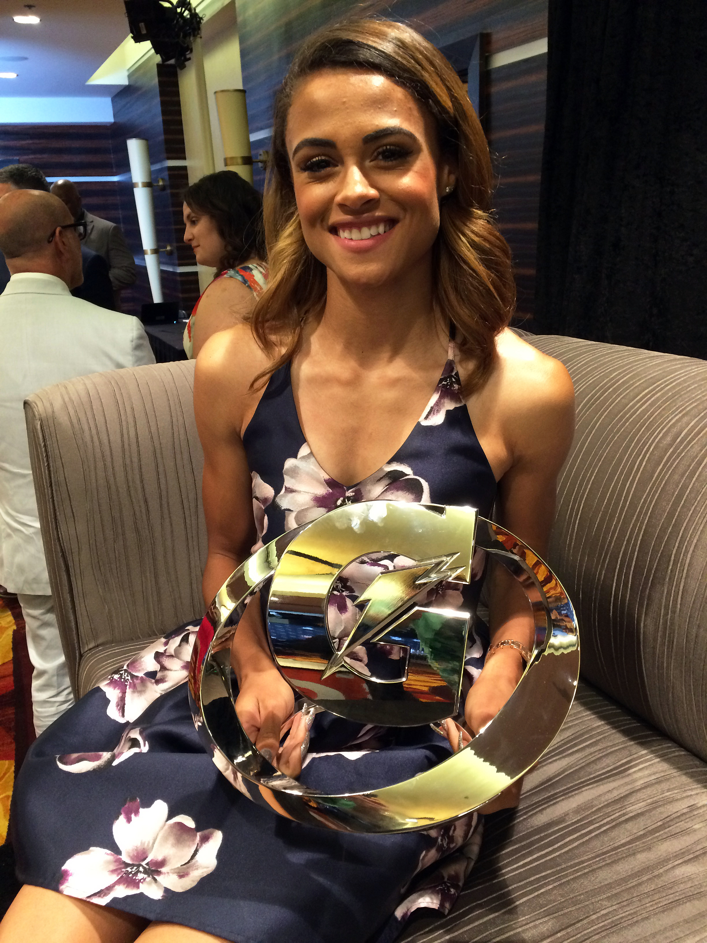 Newly minted Olympic hurdler and sprinter Sydney McLaughlin, holds her award after she was honored, along with Jayson Tatum (not pictured), a forward headed to Duke, as the national prep athletes of the year Tuesday night, July 12, 2016, in Los Angeles. M