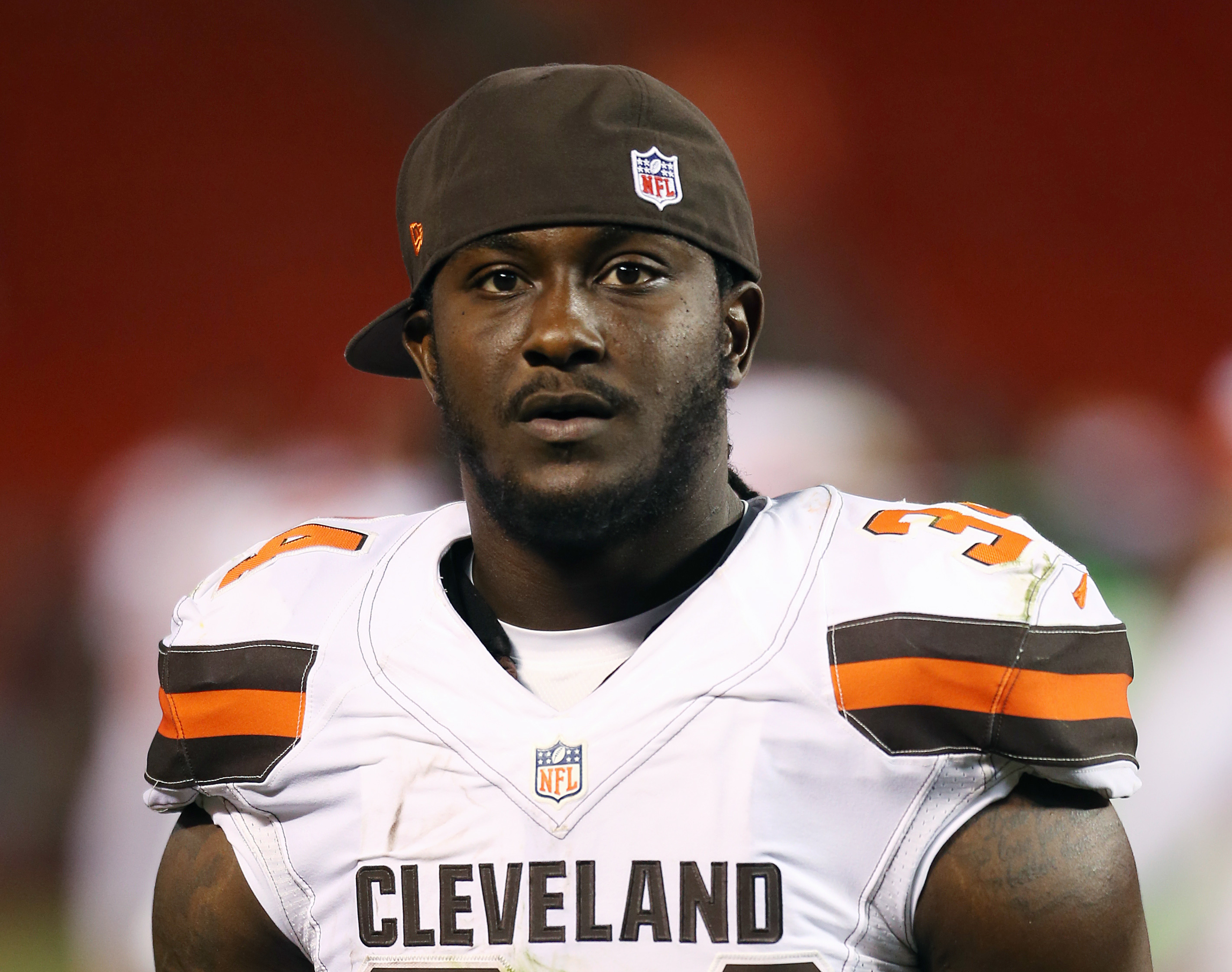 FILE - In this Aug. 13, 2015, file photo, Cleveland Browns running back Isaiah Crowell (34) is shown during an NFL preseason football game against the Washington Redskins in Cleveland. Crowell says he will donate about $35,000 to a fallen officers' fund i