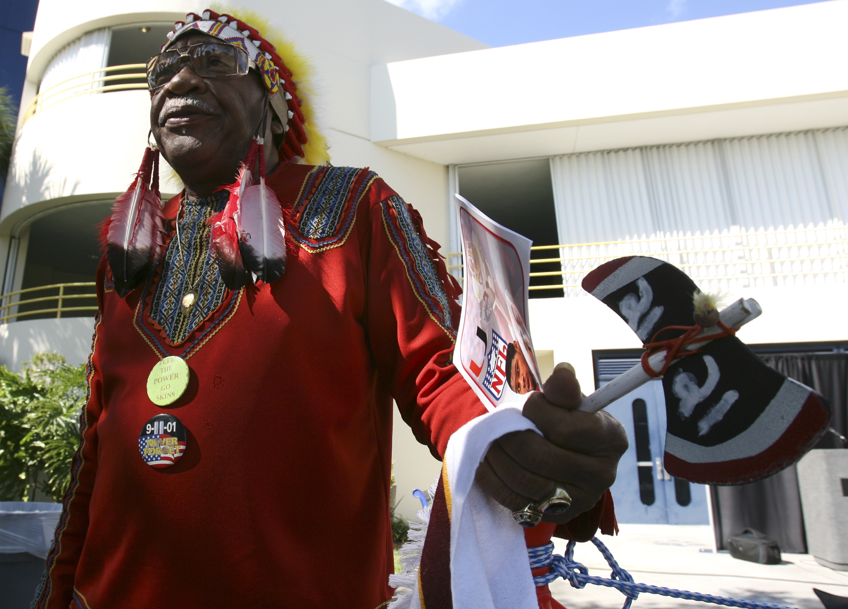 FILE - In this Dec. 3, 2007, file photo, Washington Redskins football fan Zema Williams stands outside of the funeral for Washington Redskins safety Sean Taylor at the Pharmed Arena at Florida International University in Miami. The team announced Tuesday,