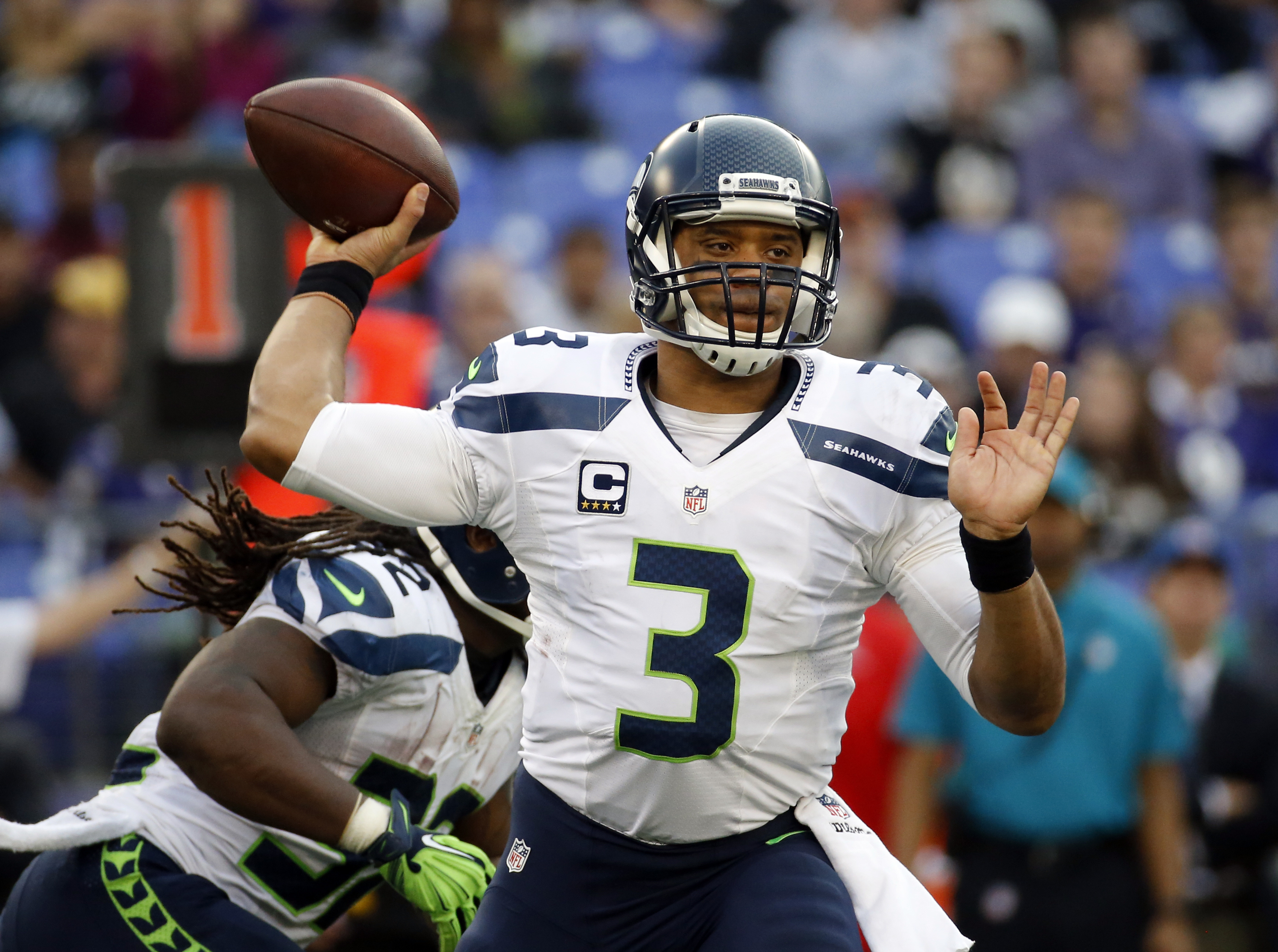 FILE - In this Dec. 13, 2015, file photo, Seattle Seahawks quarterback Russell Wilson looks to pass during an NFL football game against the Baltimore Ravens in Baltimore. The Seahawks begin training camp on July 30, 2016 with relatively few questions. The