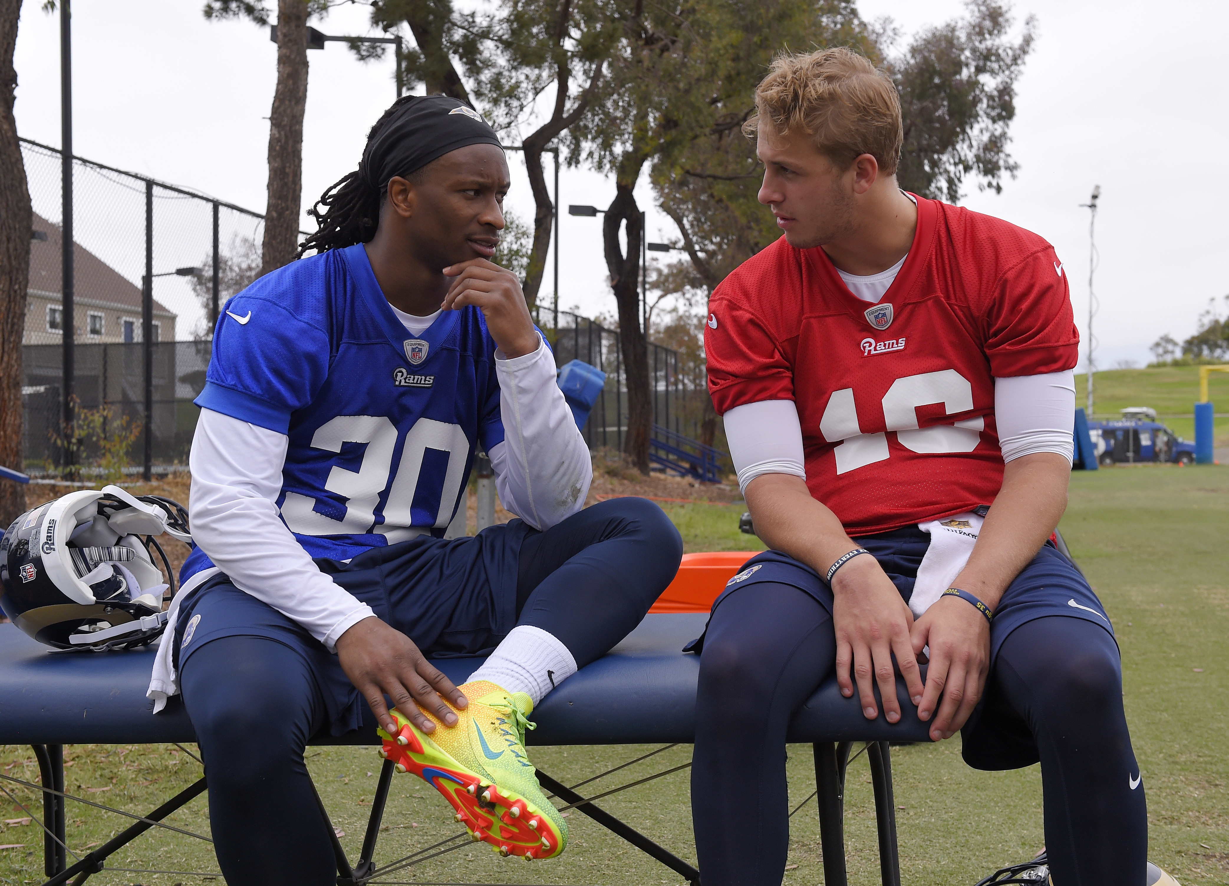 FILE - In this June 1, 2016, file photo, Los Angeles Rams running back Todd Gurley , left, talks with quarterback Jared Goff during NFL football practice in Oxnard, Calif. The Rams hopes are built around a revitalization of the NFLs worst offense last sea