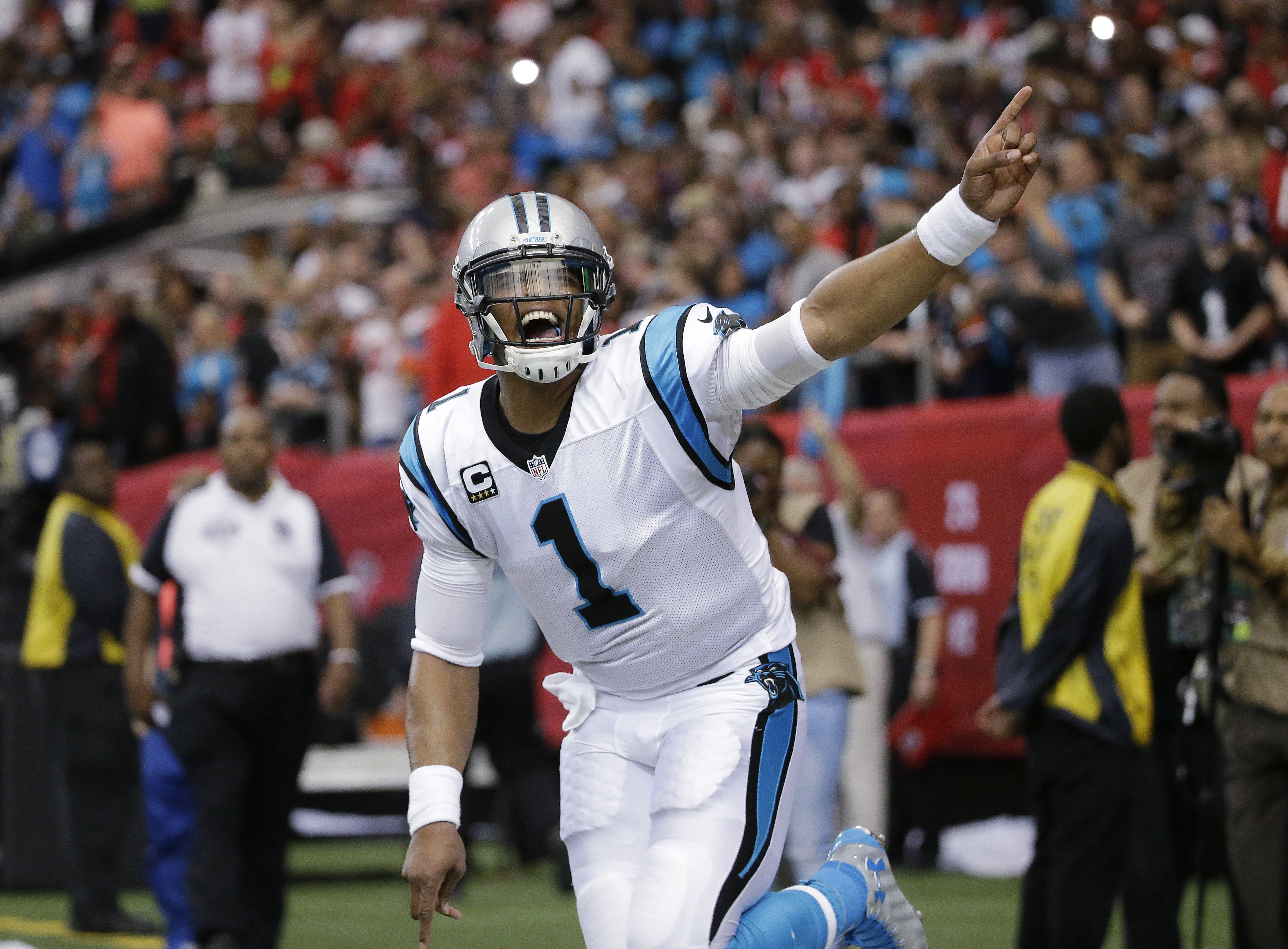 FILE - In this Dec. 27, 2015, file photo, Carolina Panthers quarterback Cam Newton celebrates his touchdown against the Atlanta Falcons during the first half of an NFL football game in Atlanta. Newton, the NFL MVP last season, anchors the top-scoring offe