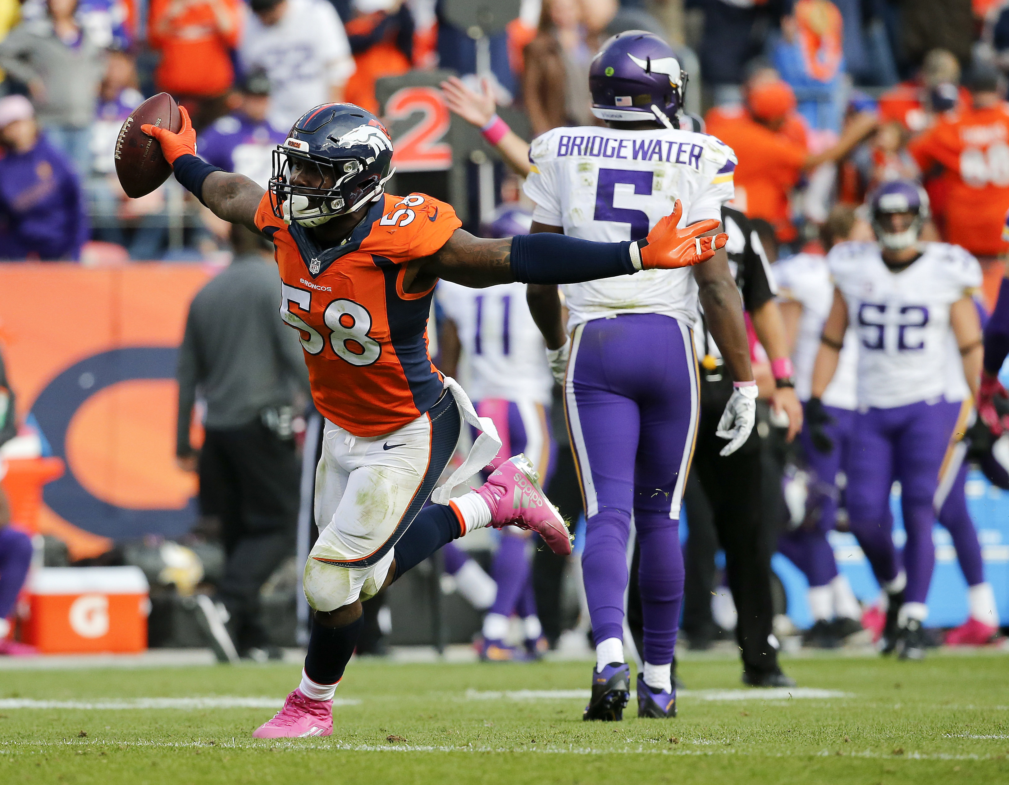 FILE - In this Oct. 4, 2015, file photo, Denver Broncos outside linebacker Von Miller (58) celebrates after sacking Minnesota Vikings quarterback Teddy Bridgewater (5) during the second half of an NFL football game, in Denver. Von Miller is back to lead D