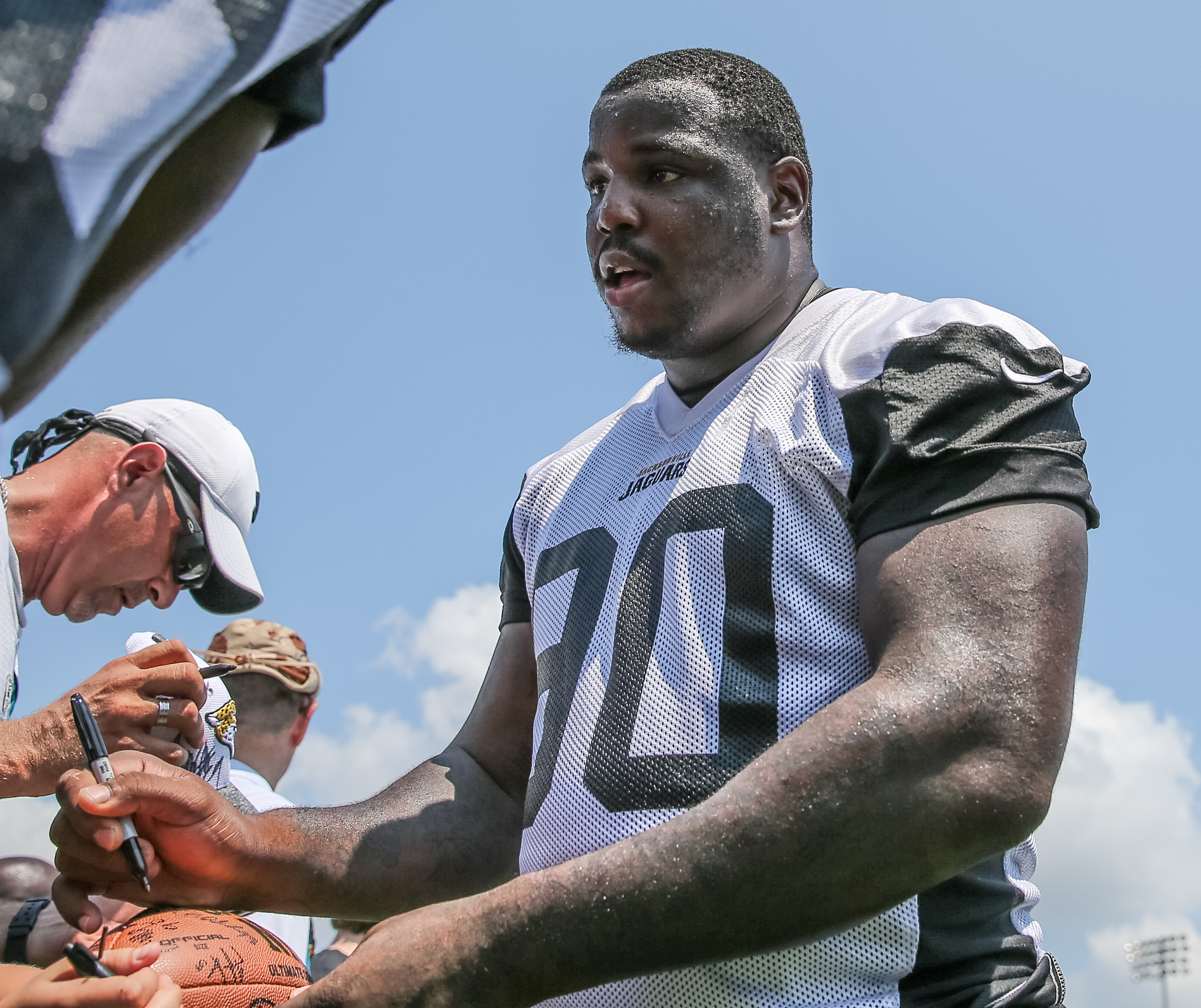FILE - In this June 14, 2016, file photo, Jacksonville Jaguars defensive tackle Malik Jackson (90) signs a fan's football after an NFL football minicamp practice in Jacksonville, Fla. The overhaul is complete. The pieces are in place. And for the first ti