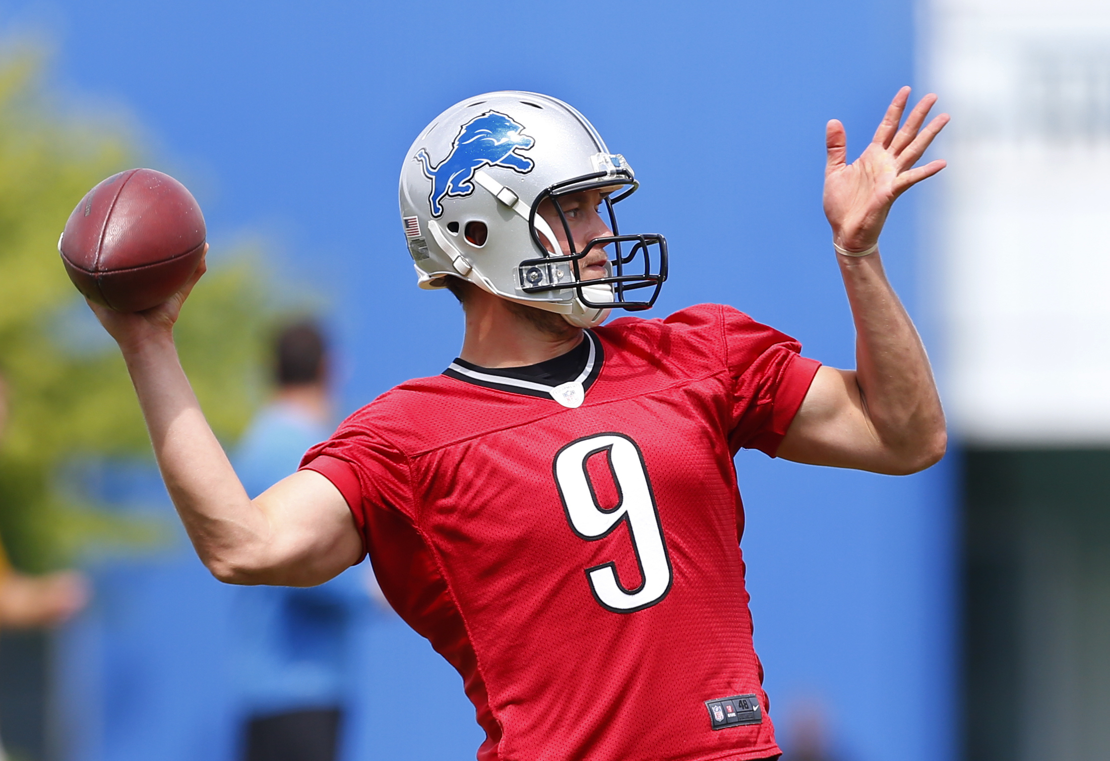 FILE - In this June 14, 2016, file photo, Detroit Lions quarterback Matthew Stafford throws during NFL football practice in Allen Park, Mich. Stafford has been sacked 89 times the past two years, ranking among NFL leaders. The Lions averaged a league-low