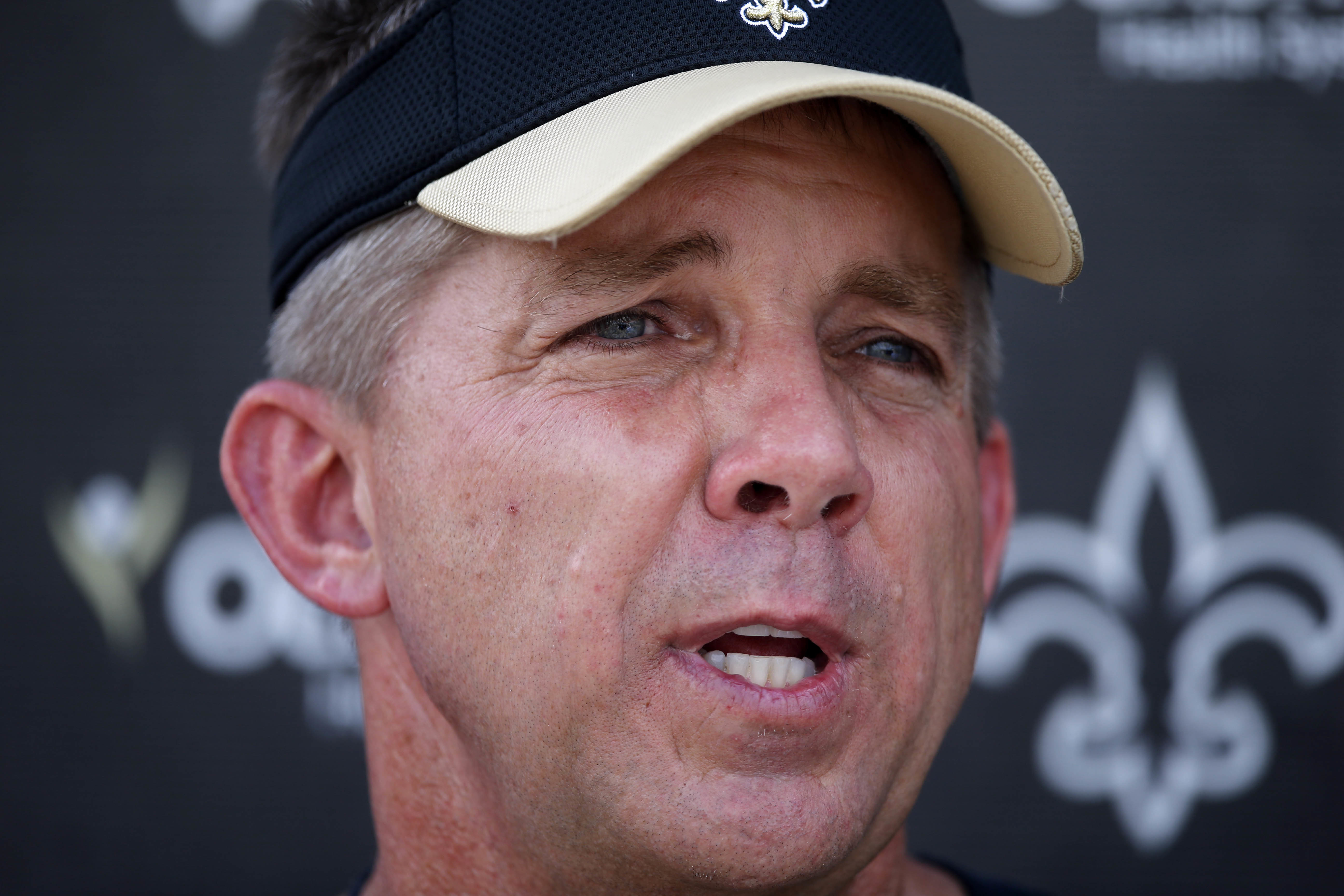 FILE - In this May 26, 2016, file photo, New Orleans Saints head coach Sean Payton talks to reporters after an NFL football practice in Metairie, La. The Saints open training camp in White Sulphur Springs, West Virginia, on July 27.  (AP Photo/Gerald Herb