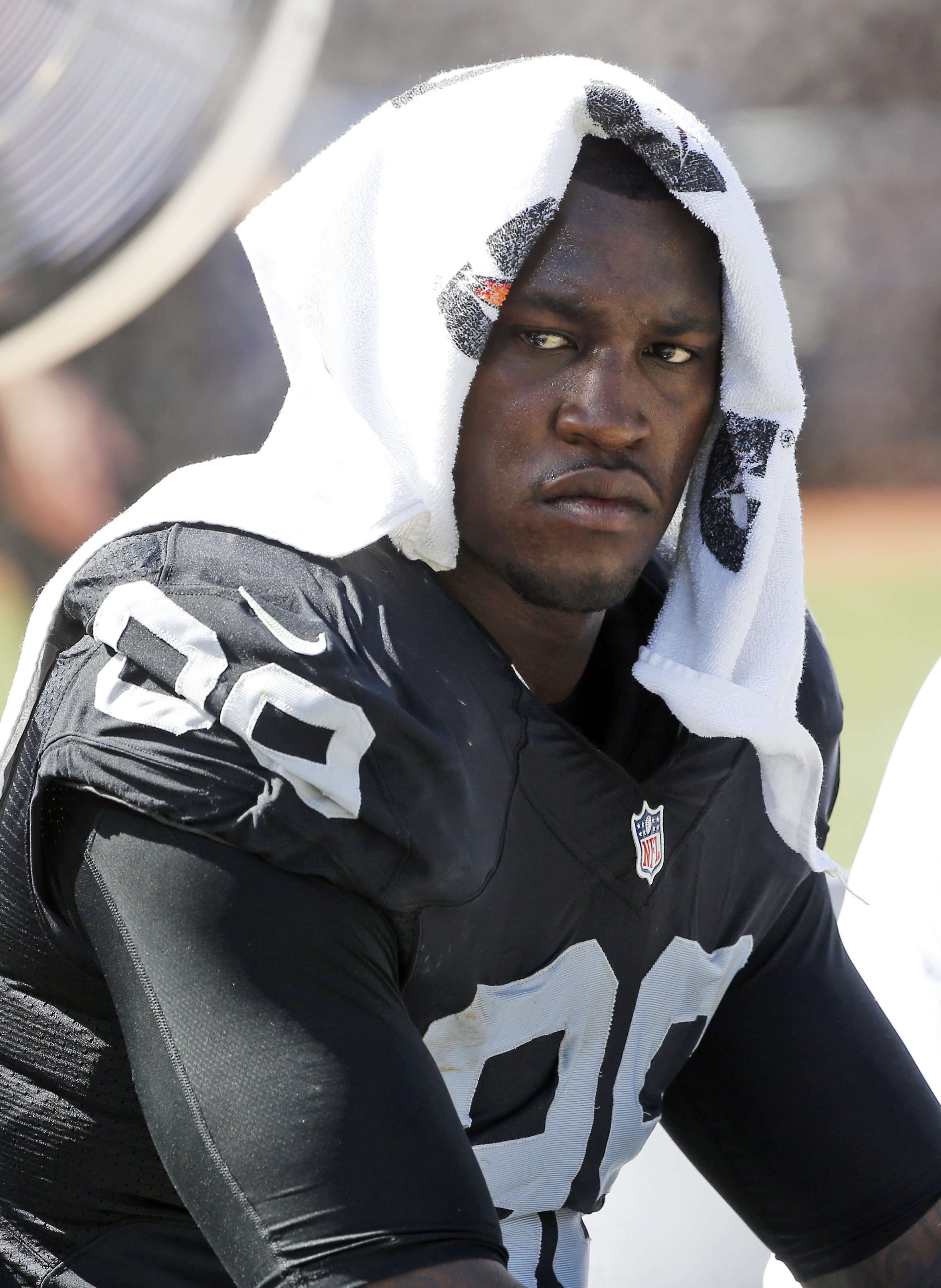 Oakland Raiders defensive end Aldon Smith (99) cools off during an NFL football game against the Baltimore Ravens Sunday, Sept. 20, 2015, in Oakland , Calif. (AP Photo/Tony Avelar)