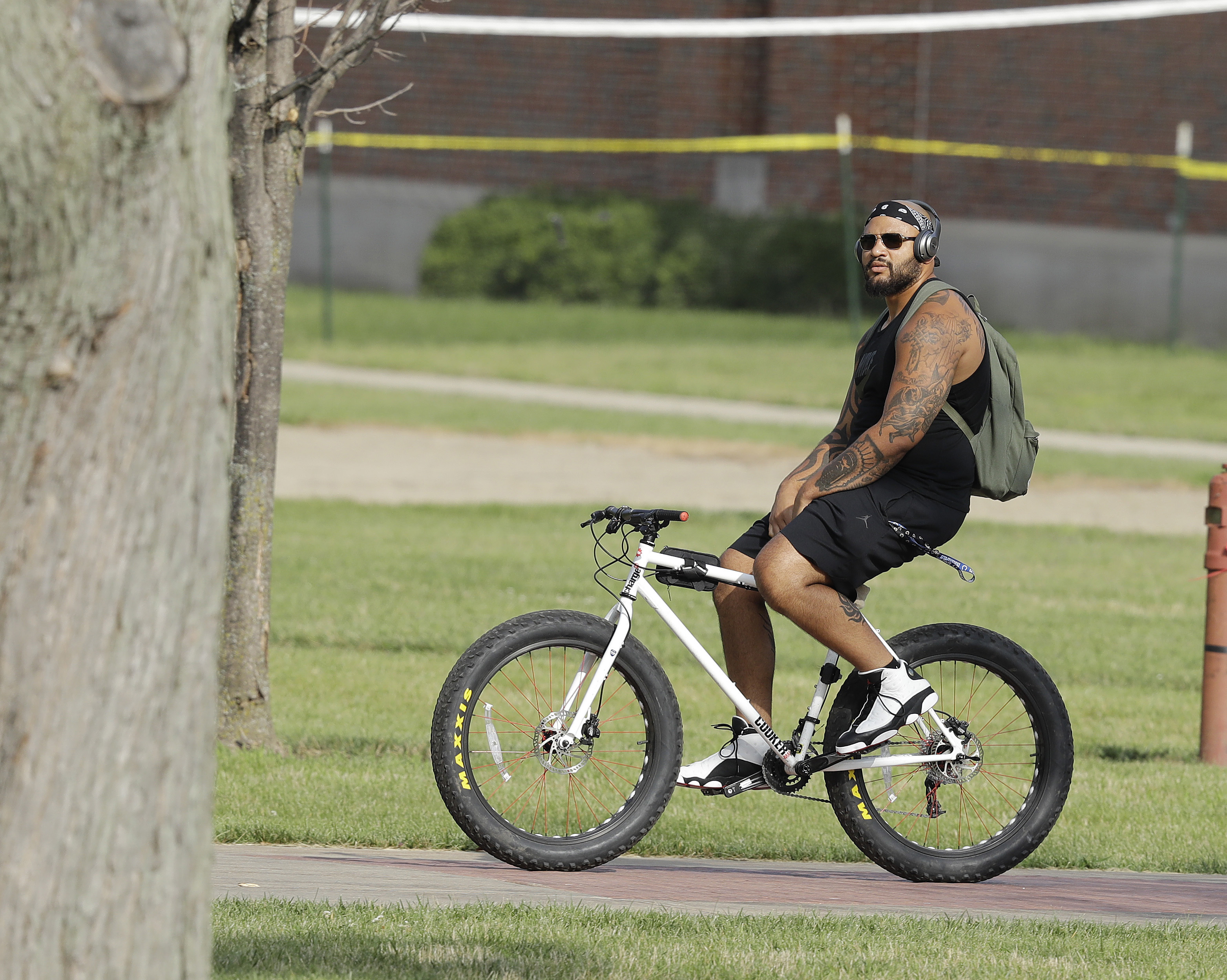 Indianapolis Colts offensive lineman Hugh Thornton rides his bike after arriving for an NFL football training camp, Tuesday, July 26, 2016, in Anderson, Ind. (AP Photo/Darron Cummings)