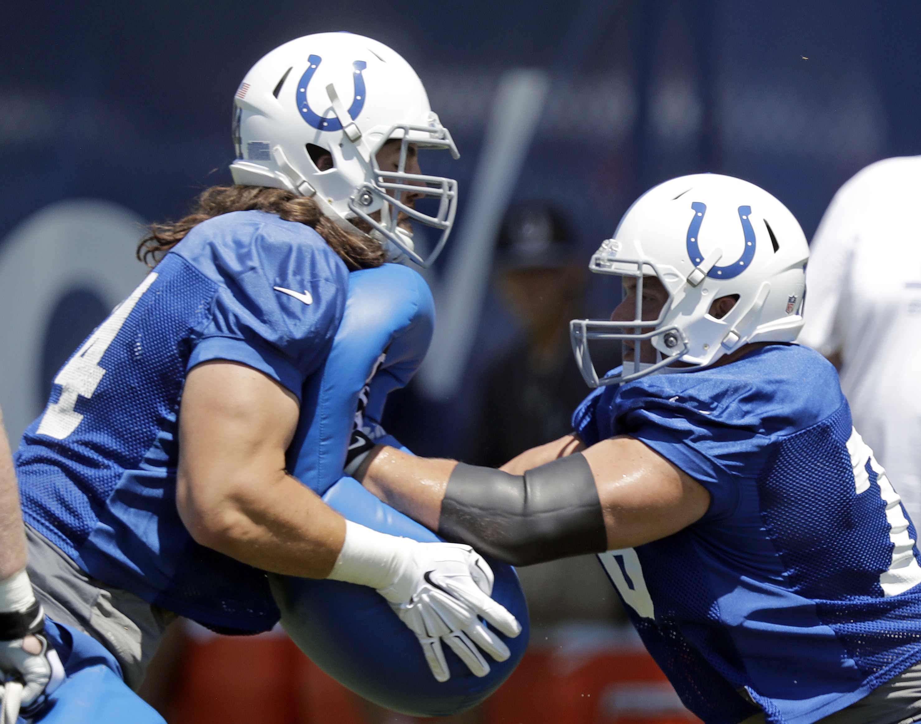 Indianapolis Colts center Ryan Kelly, right, and Anthony Castonzo run a drill during an NFL football training camp, Wednesday, July 27, 2016, in Anderson, Ind. (AP Photo/Darron Cummings)