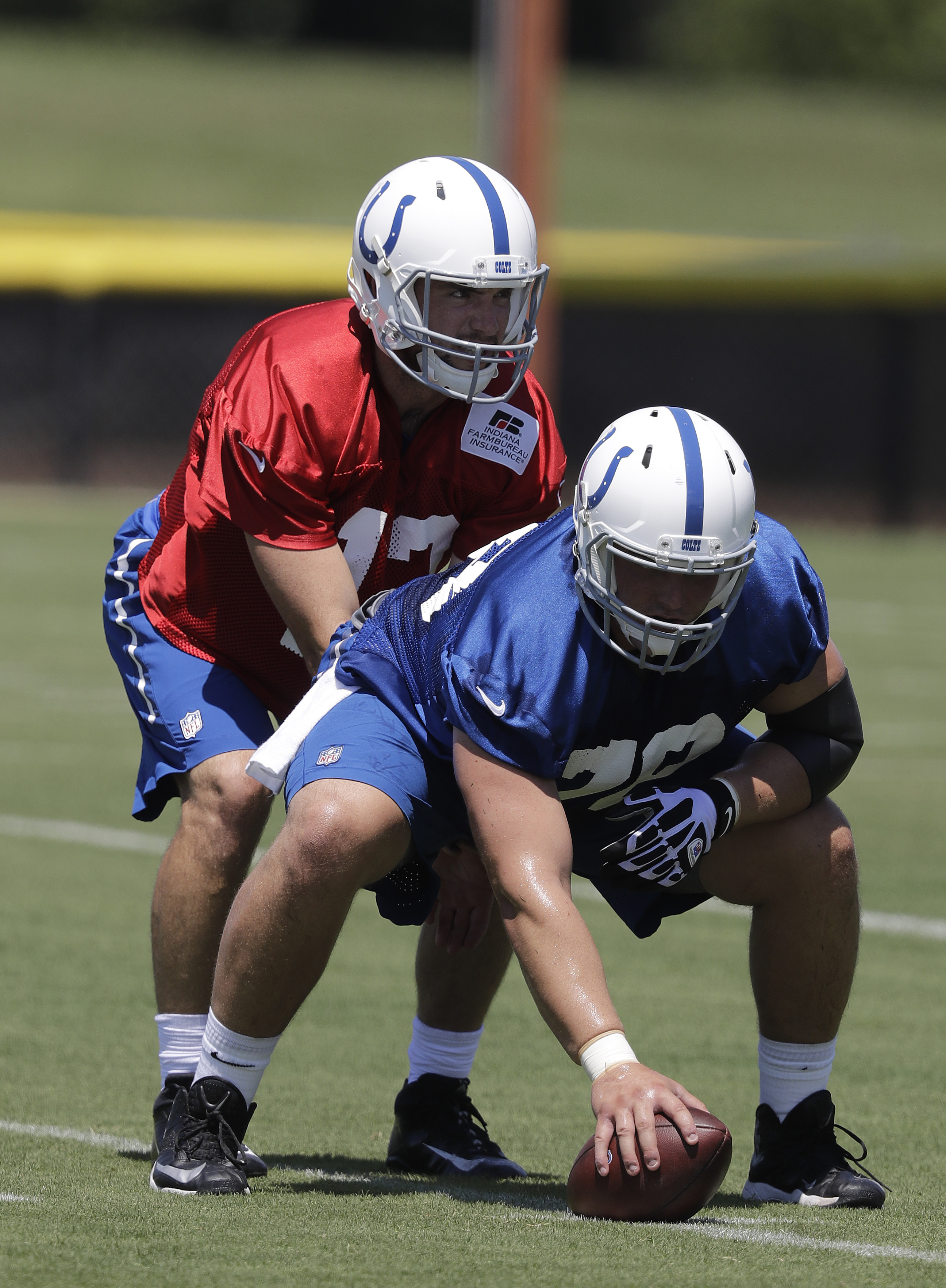 Indianapolis Colts quarterback Andrew Luck and center Ryan Kelly run a drill during an NFL football training camp, Wednesday, July 27, 2016, in Anderson, Ind. (AP Photo/Darron Cummings)