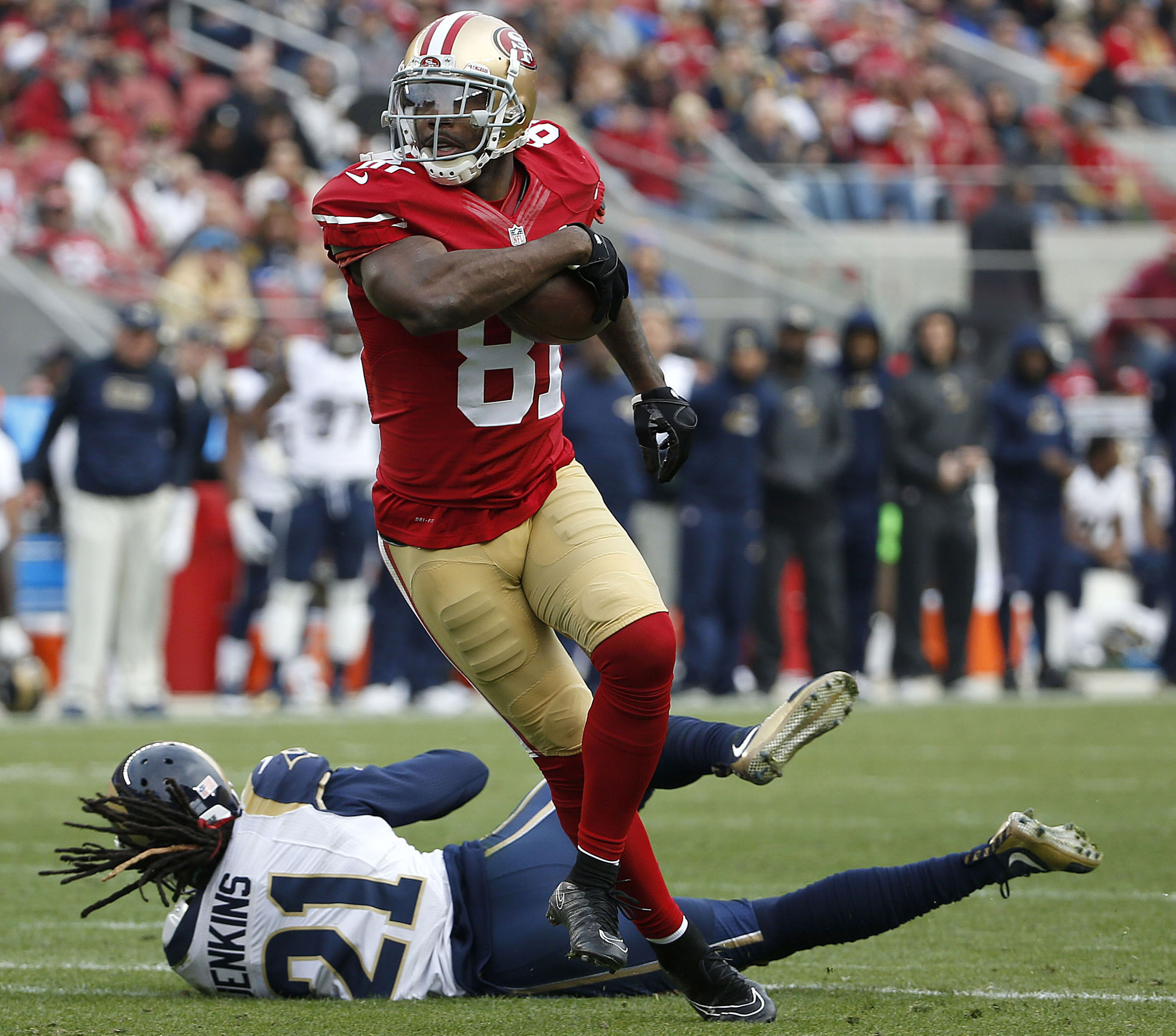 File-This Jan. 3, 2016, file photo shows San Francisco 49ers wide receiver Anquan Boldin (81) catching a touchdown pass against St. Louis Rams cornerback Janoris Jenkins (21) during the first half of an NFL football game in Santa Clara, Calif. The Detroit