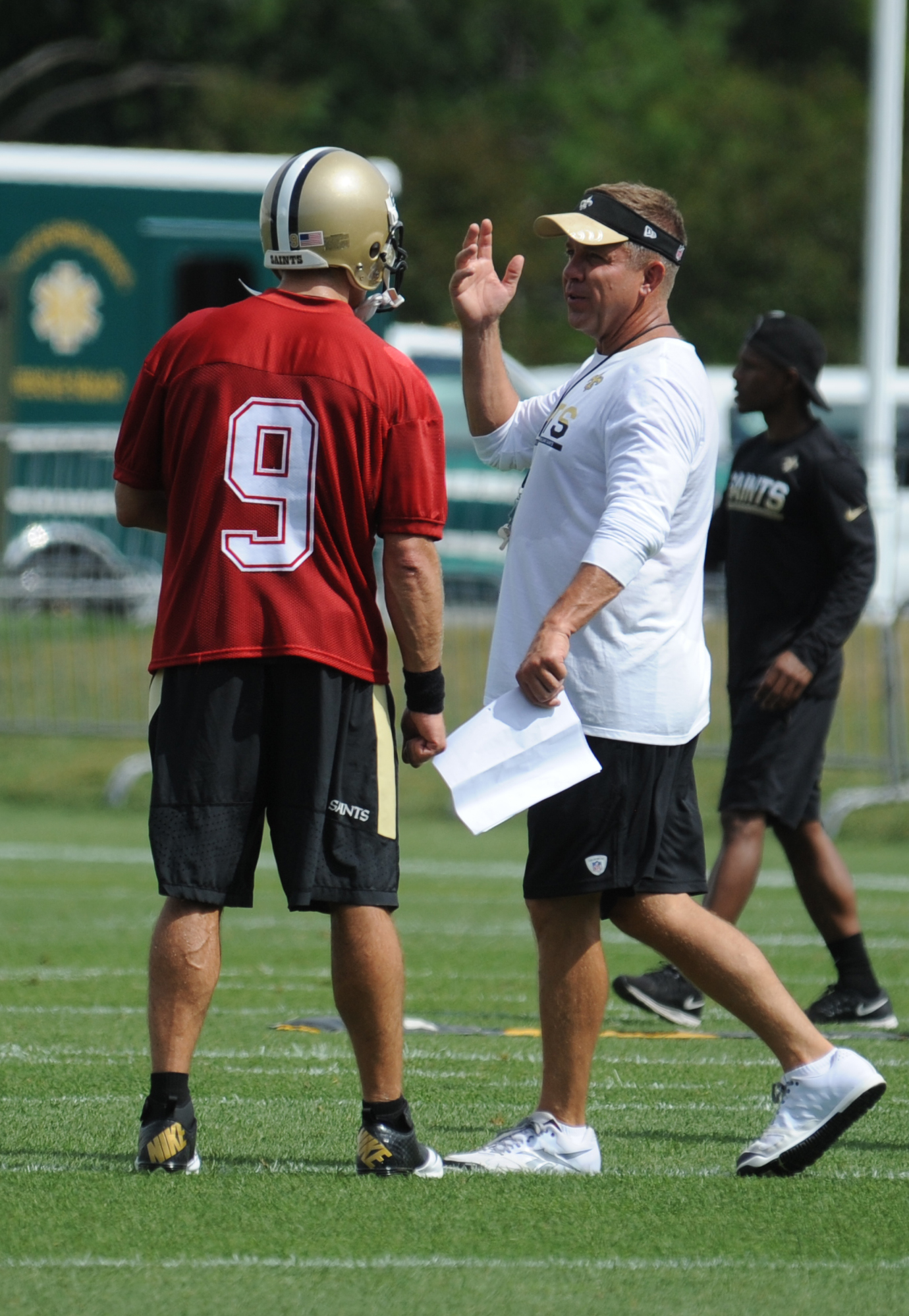 New Orleans Saints quarterback Drew Brees (9) talks with head coach Sean Payton during the NFL football teams  training camp in White Sulphur Springs, W.Va., Thursday, July 28, 2016. (AP Photo/Chris Tilley)