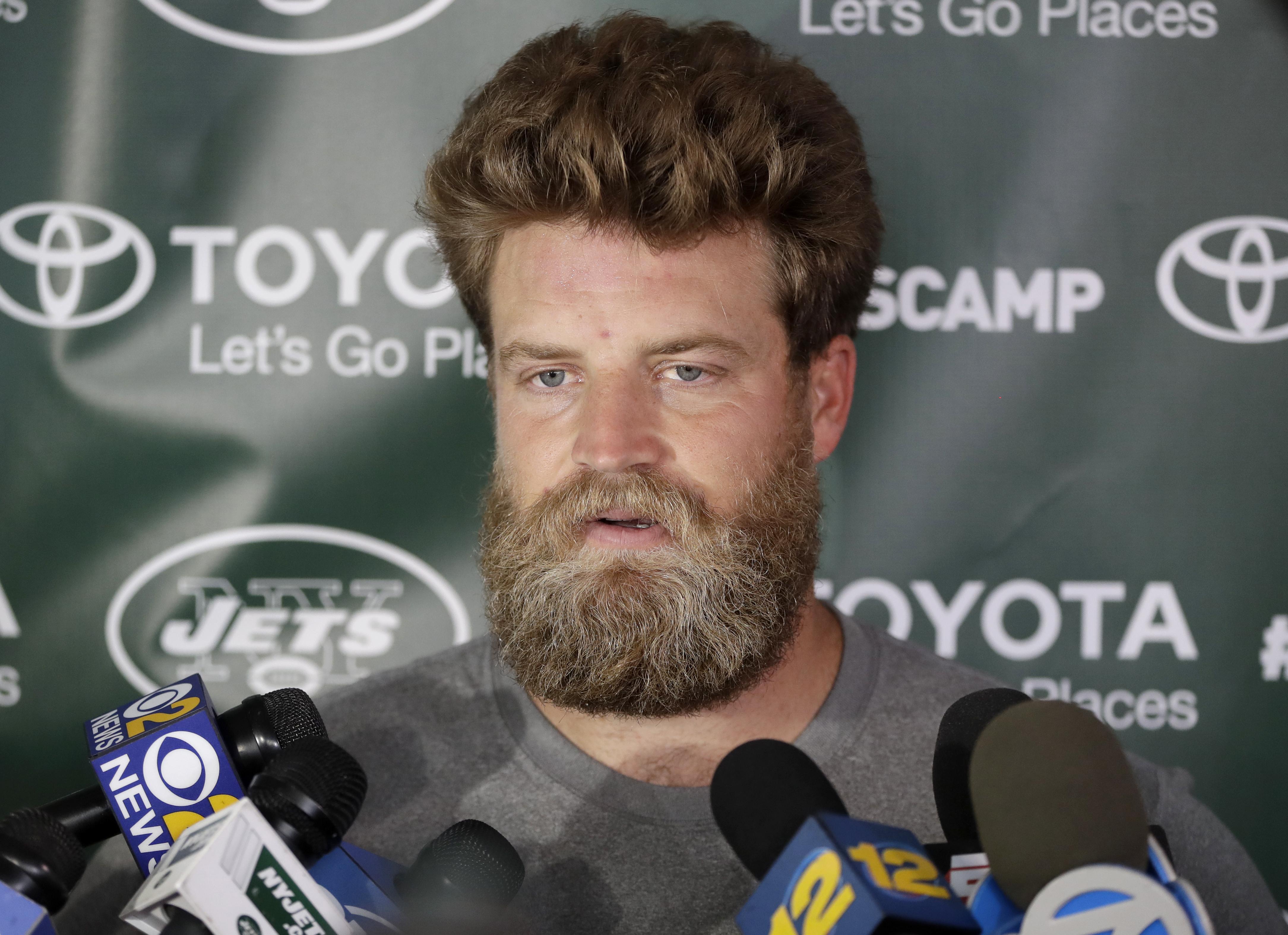 New York Jets quarterback Ryan Fitzpatrick talks to reporters during NFL football training camp, Thursday, July 28, 2016, in Florham Park, N.J. (AP Photo/Julio Cortez)
