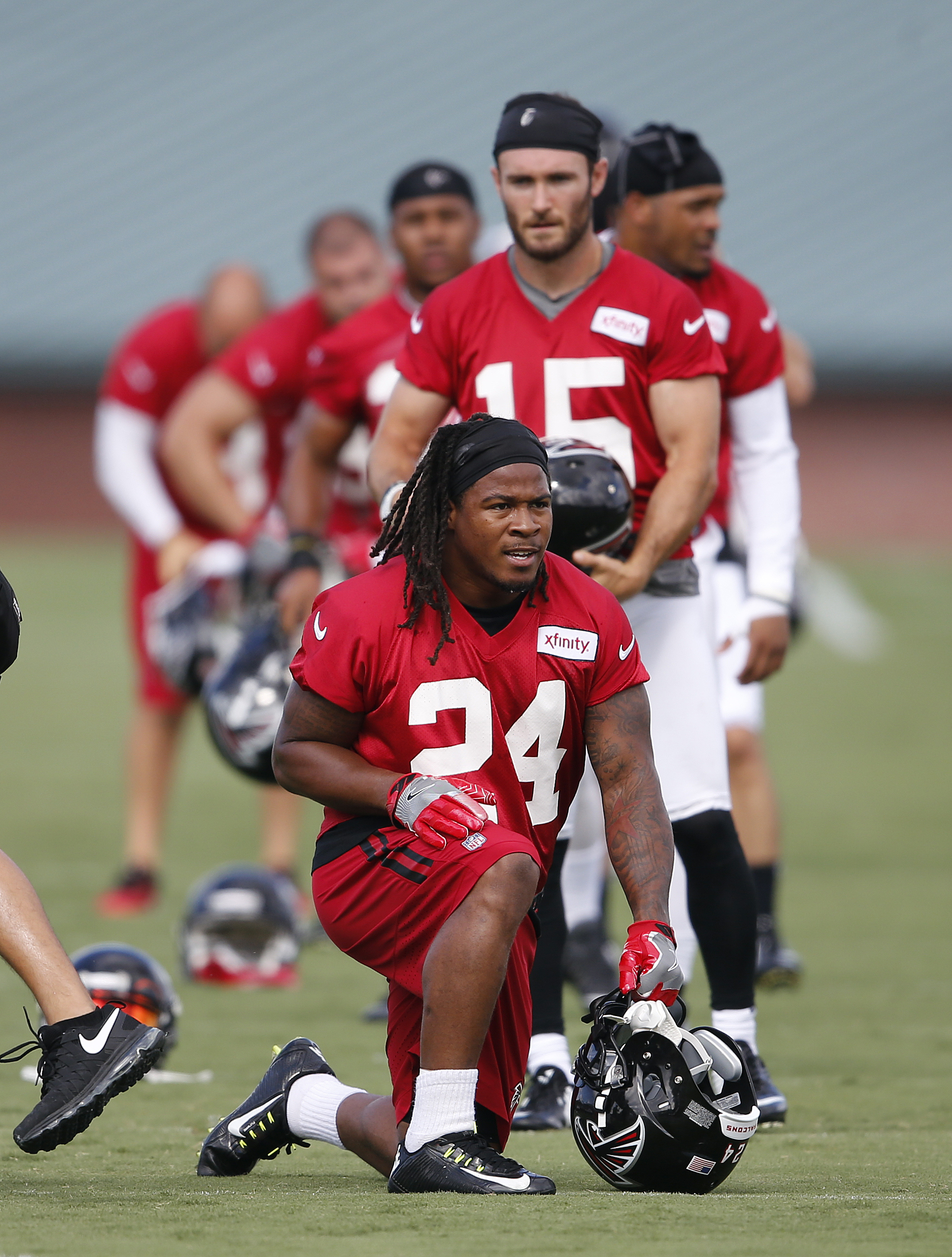 Atlanta Falcons running back Devonta Freeman (24) stretches during during an NFL football practice Friday, July 29, 2016, in Flowery Branch, Ga. (AP Photo/John Bazemore)